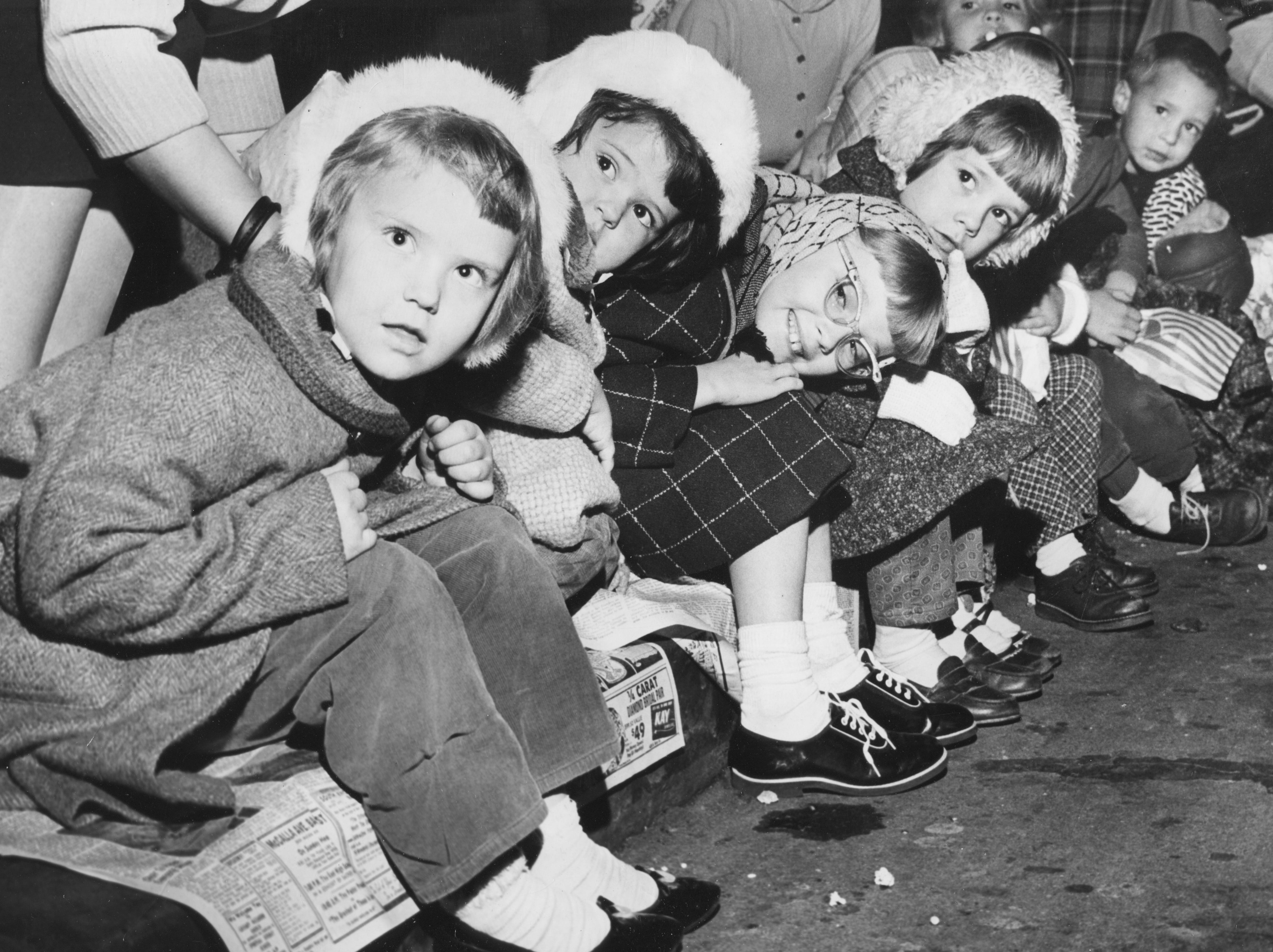 Debbie Cupp, 5, left, Teresa Cupp, 3, Vivian Mitchell, 8, and Vicky Atchley, 5, wait for Santa during the Christmas parade Nov. 26, 1961, on Gay Street.