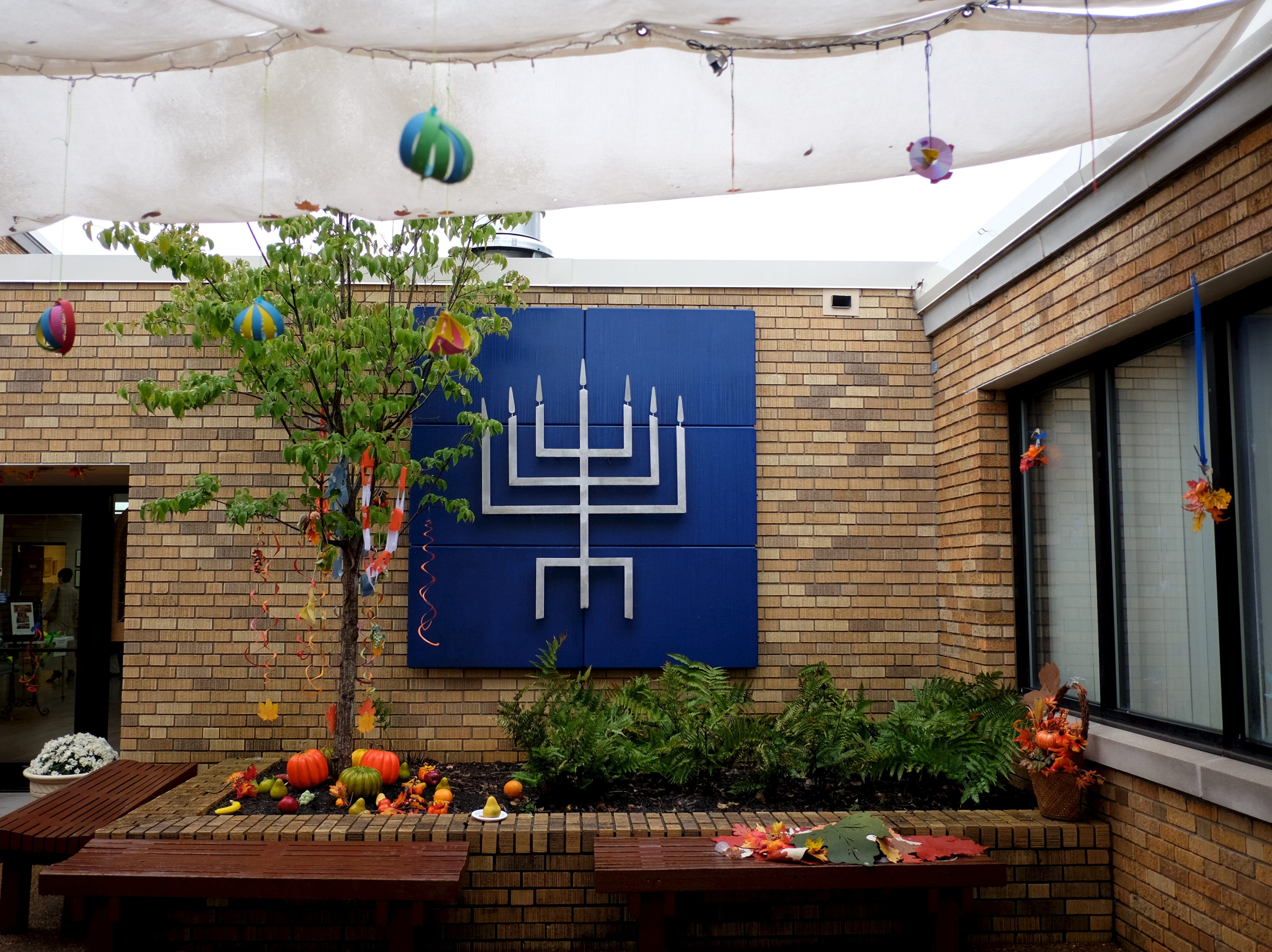 Temple Beth El's Menorah is shown beneath their Sukkah during the Jewish holiday, The Fest of Sukkot, in part of their 150th year celebration as a congregation on Friday, October 10, 2014 in Knoxville, Tenn.