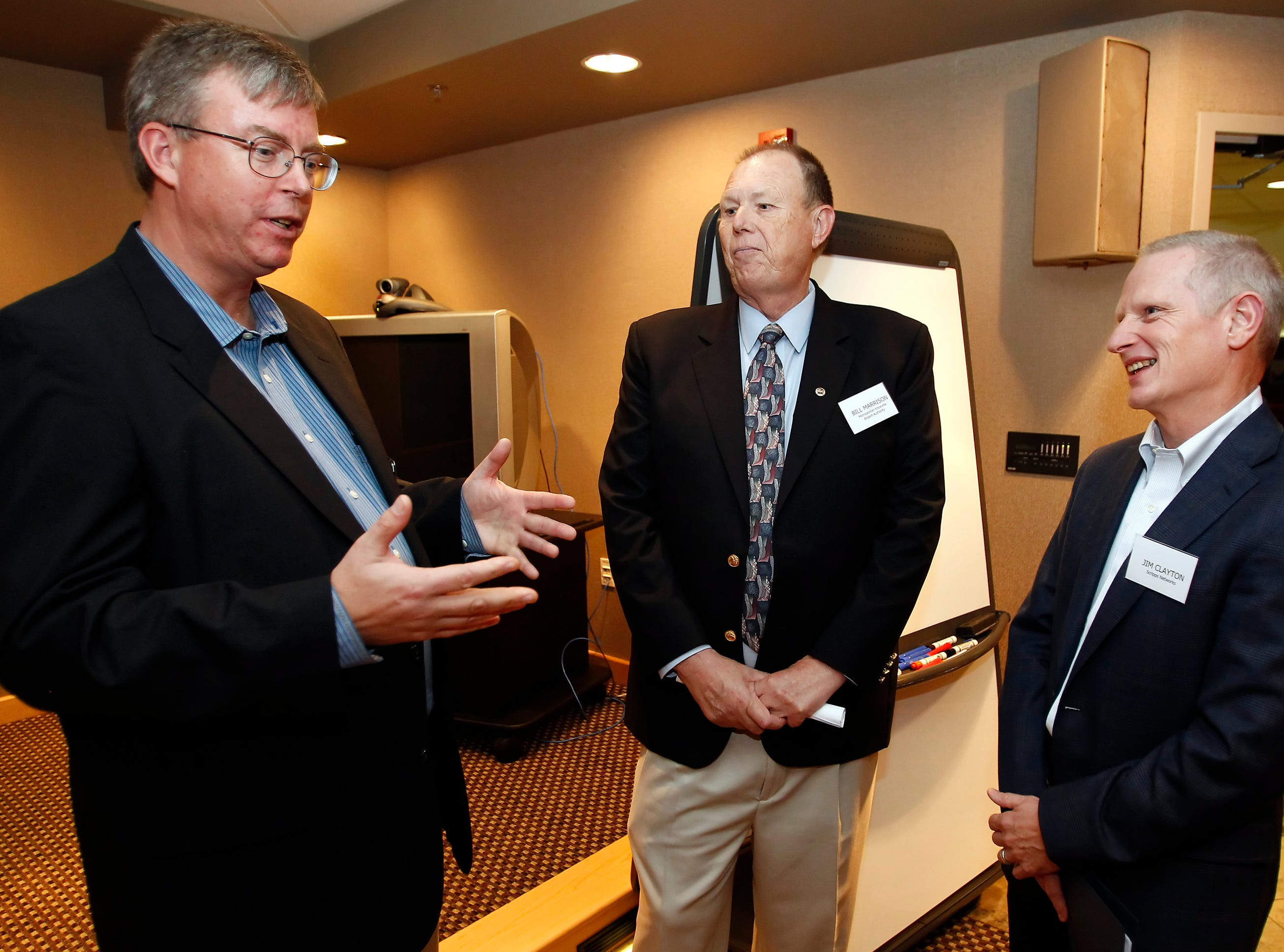 Bill Westgate, Frontier Airlines' Senior Director of Planning and Strategy, left, speaks with Bill Marrison, president of the Metropolitan Knoxville Airport Authority, center, and Jim Clayton, Executive Vice President, Planning and Strategy, Lifestyle Media Division, Scripps Networks Interactive speak before a meeting at Scripps Networks Friday, Nov. 9, 2011.