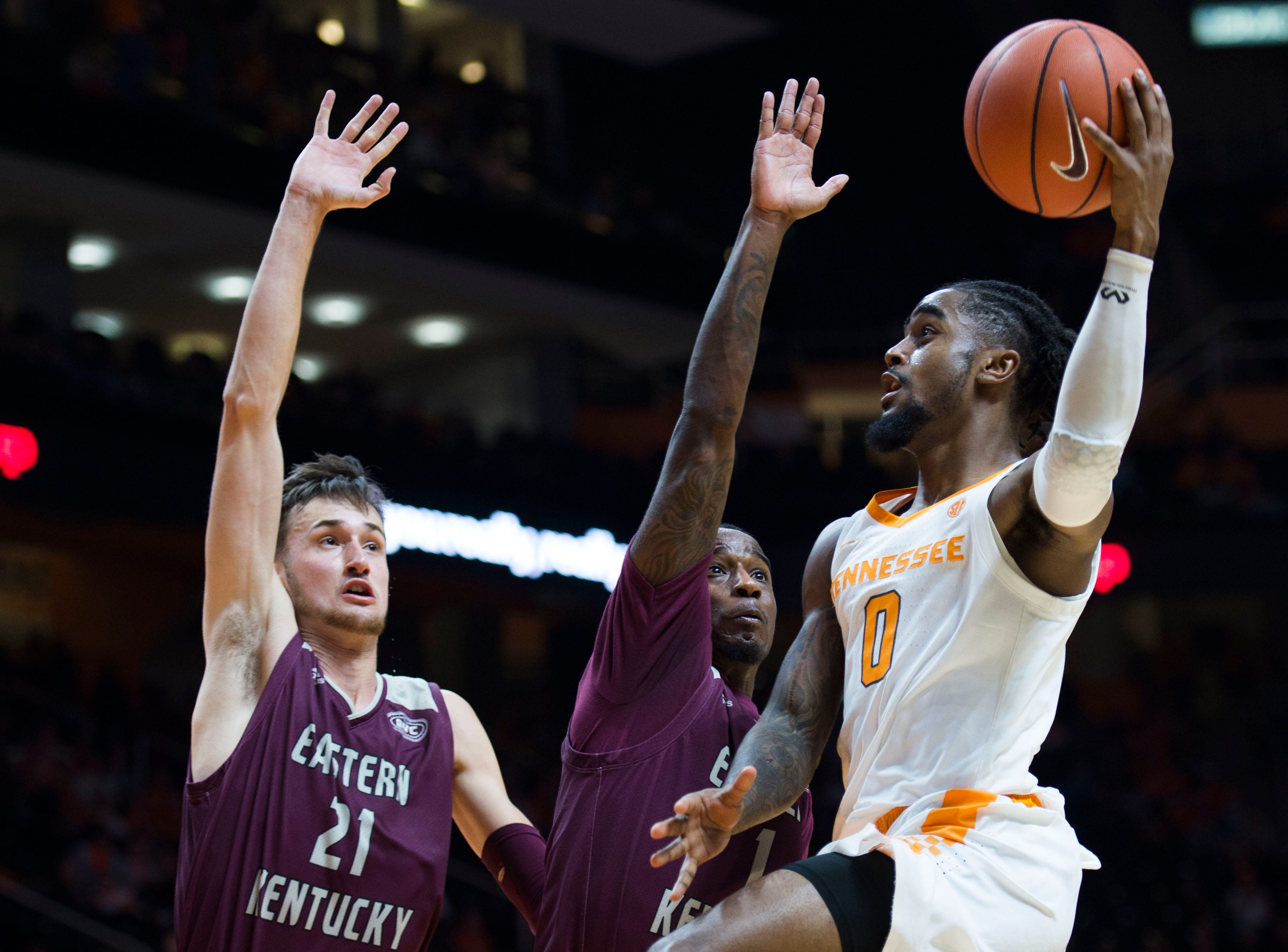 Tennessee's Jordan Bone (0) takes a shot while defended by EKU players during the second half of a NCAA men's basketball game between Tennessee and Eastern Kentucky University at Thompson-Boling Arena Wednesday, Nov. 28, 2018. Tennessee defeated EKU 95-67.
