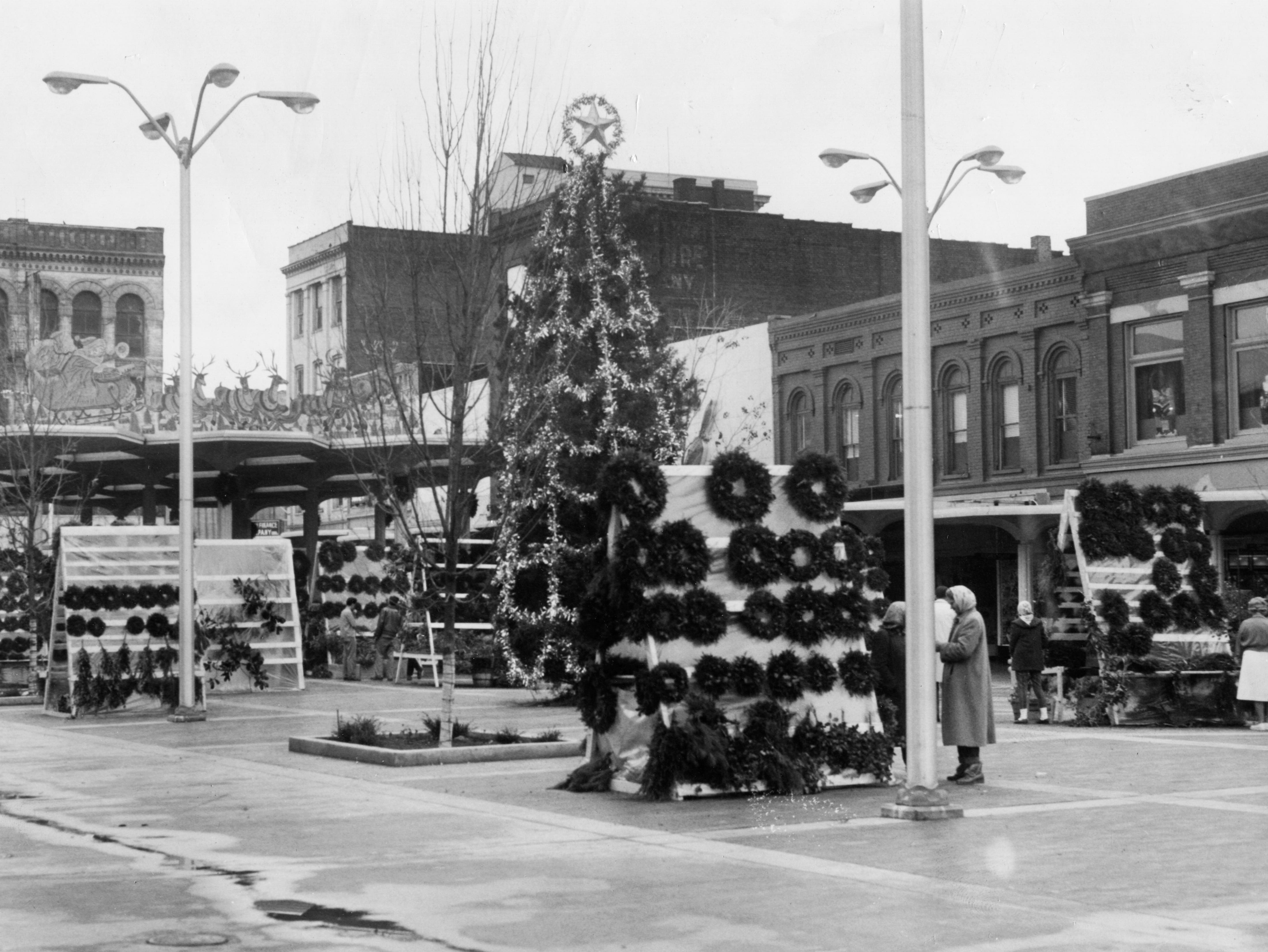 Christmas wreaths are for sale on Dec. 19, 1961, at Market Square.
