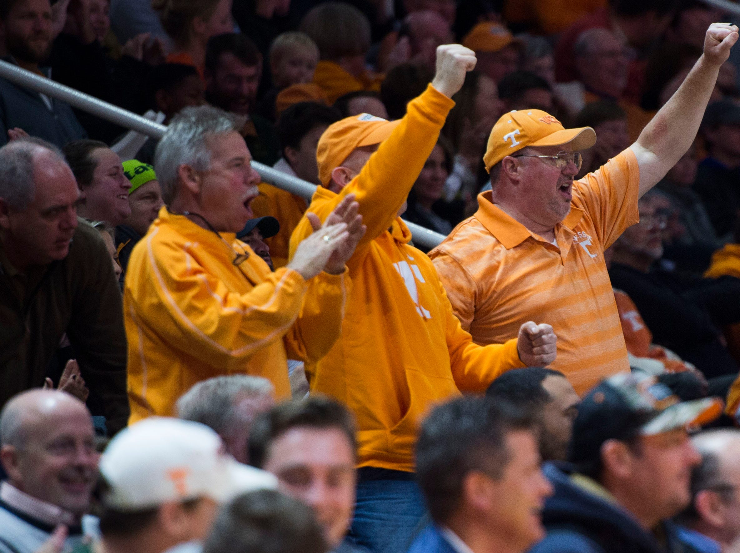 Fans cheer after a dunked ball during the first half of a NCAA men's basketball game between Tennessee and Eastern Kentucky University at Thompson-Boling Arena Wednesday, Nov. 28, 2018.