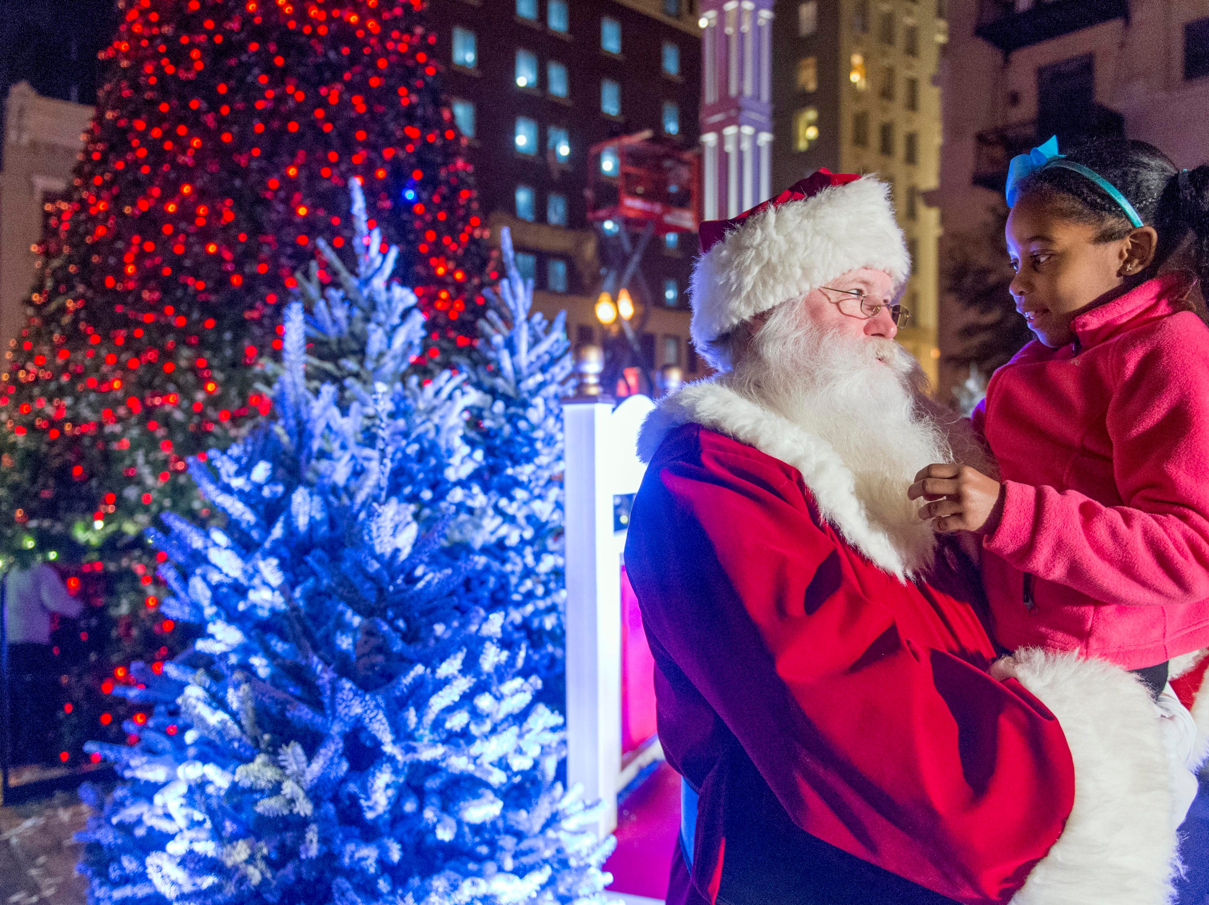 Santa is greeted by Kheri Bonds on Friday, November 25, 2016 during the Christmas in the City celebration in Downtown Knoxville. The City kicked off the holiday season with the lighting of the Downtown Christmas Tree on Friday, November 25, 2016 and the Regal Celebration of Lights.