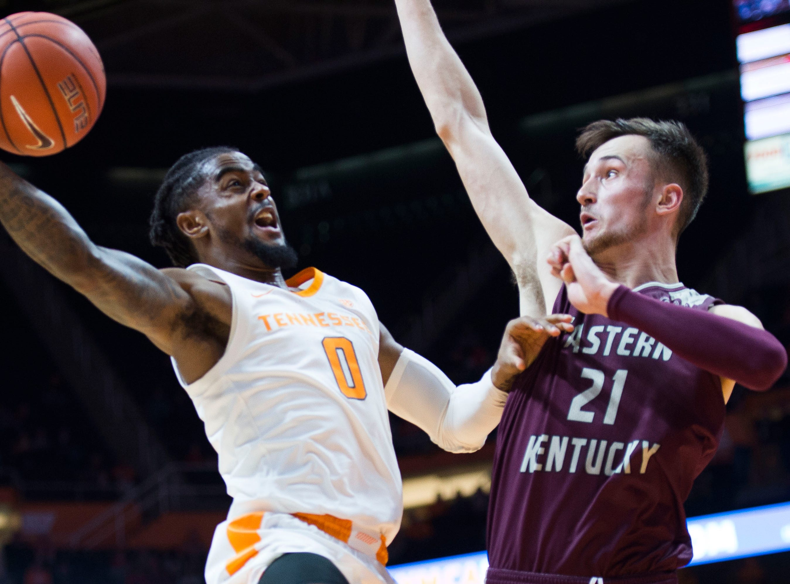 Tennessee's Jordan Bone (0) takes a shot while defended by EKU's Lachlan Anderson (21) during the first half of a NCAA men's basketball game between Tennessee and Eastern Kentucky University at Thompson-Boling Arena Wednesday, Nov. 28, 2018.