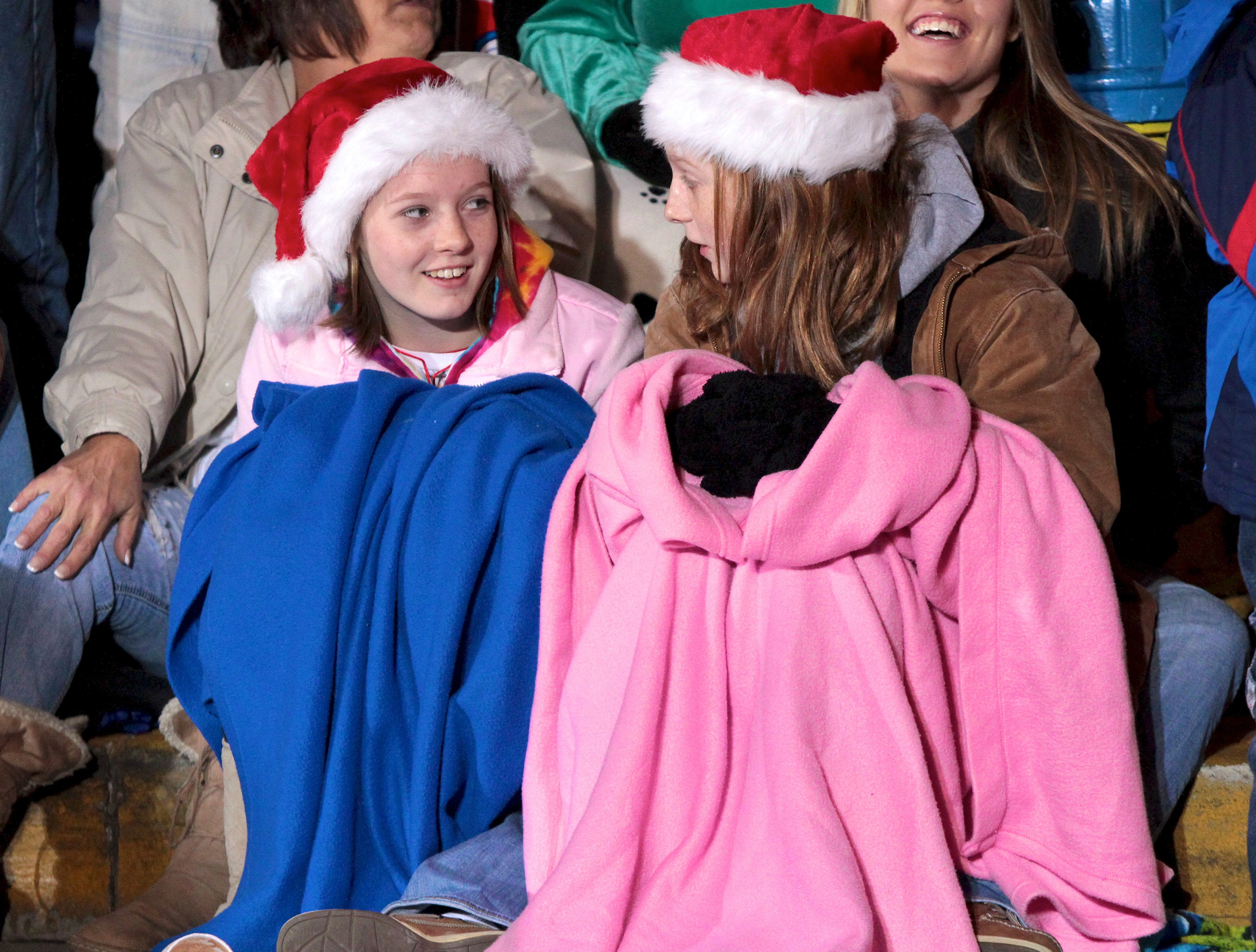 Hannah Byrd, 12, left, and Haley Pierce, 12, share a laugh during the annual Knoxville Christmas Parade on Friday, December 3, 2010.