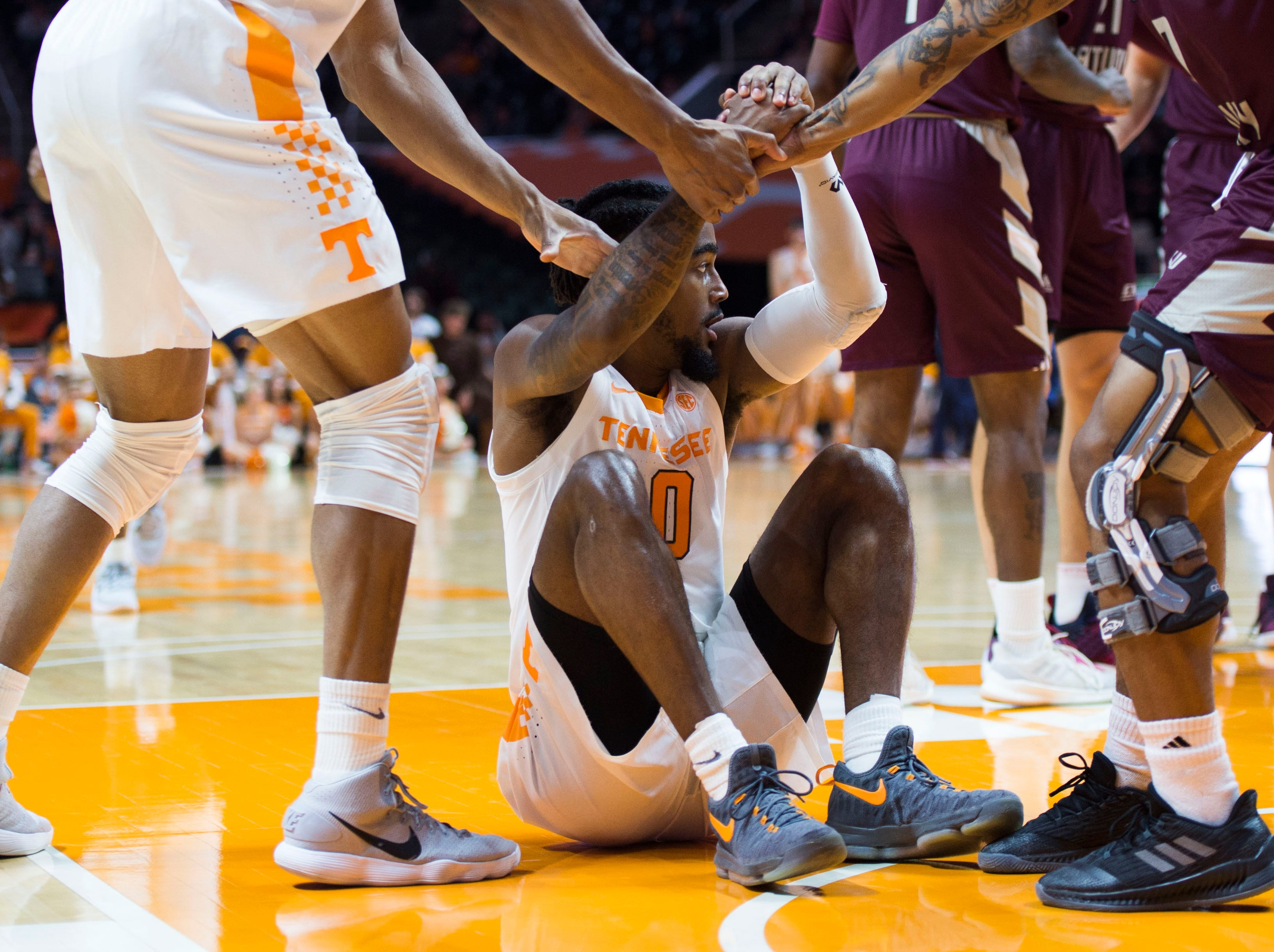 Tennessee's Jordan Bone (0) gets help up during the first half of a NCAA men's basketball game between Tennessee and Eastern Kentucky University at Thompson-Boling Arena Wednesday, Nov. 28, 2018.