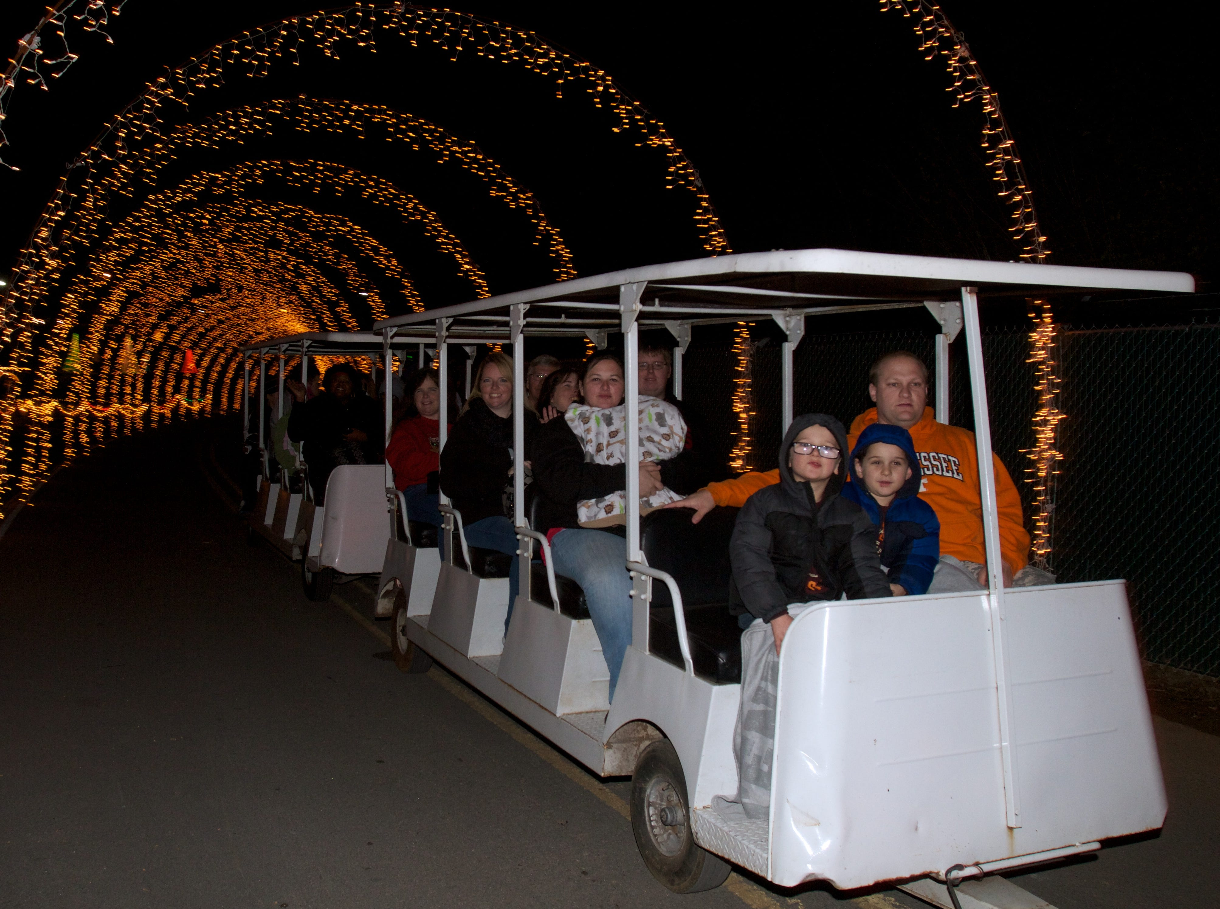 Families ride through Christmas light displays on Friday, November 30, 2012 during Comcast Christmas at Chilhowee Park.