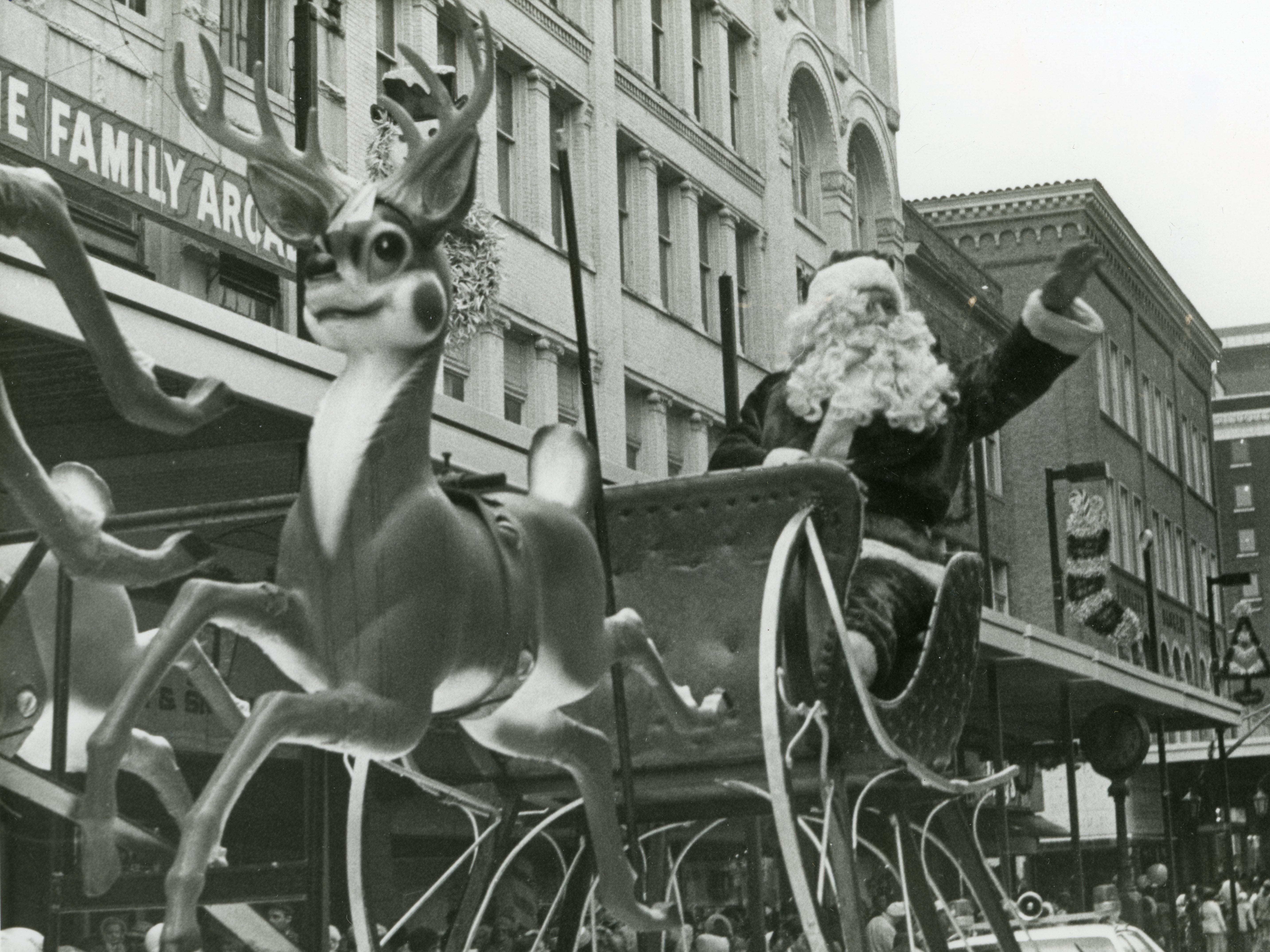 Santa rides his sleigh down Gay Street during the Knoxville Christmas parade in December 1978.