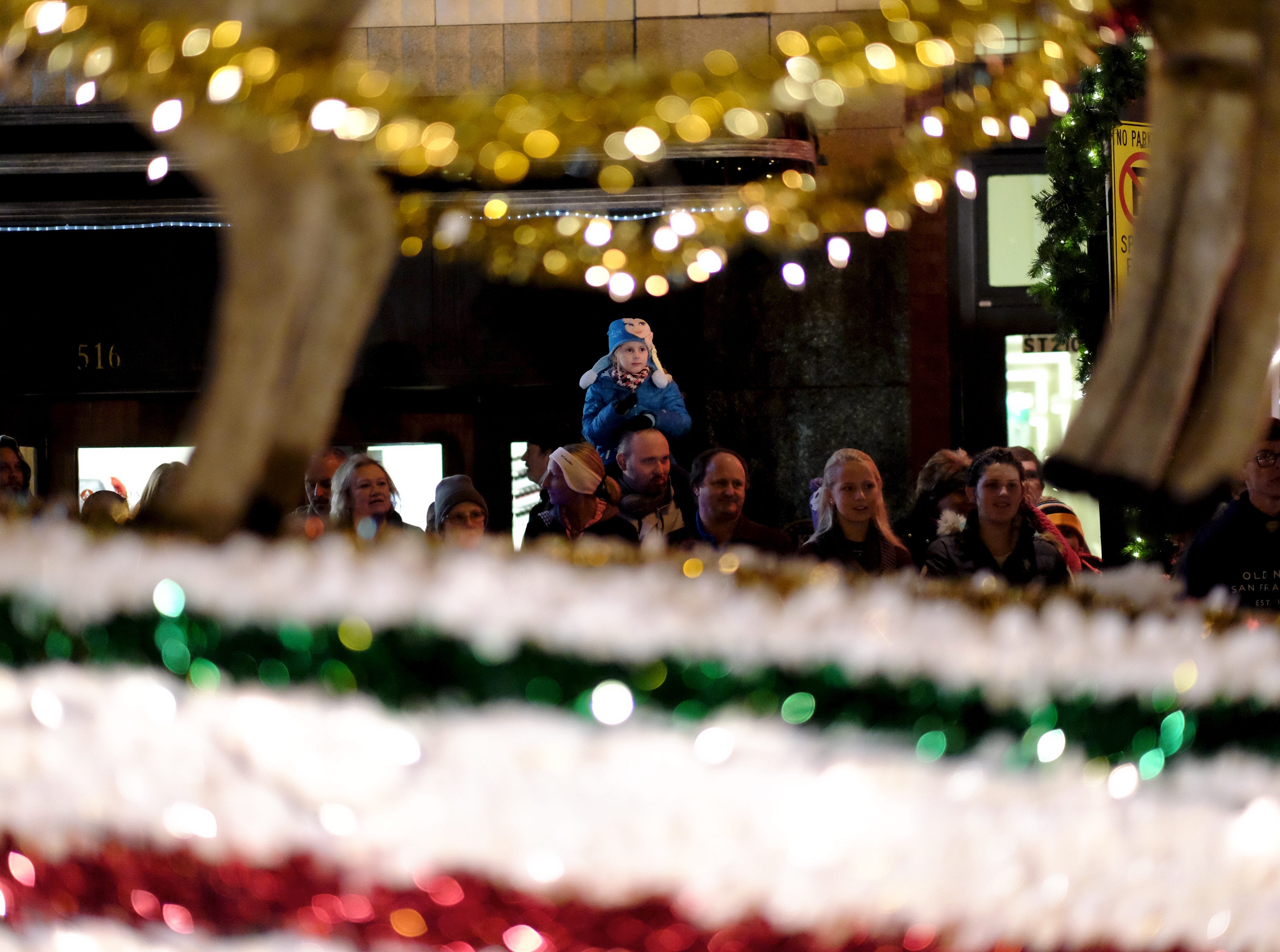 Parade spectators watch as Santa makes an appearance during the 43rd annual WIVK Christmas Parade on Friday, December 4, 2015, in Knoxville.
