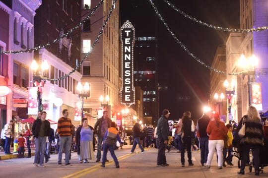 Pedestrians fill Gay Street during the Christmas in the City kickoff in downtown Knoxville on Nov. 27, 2015.