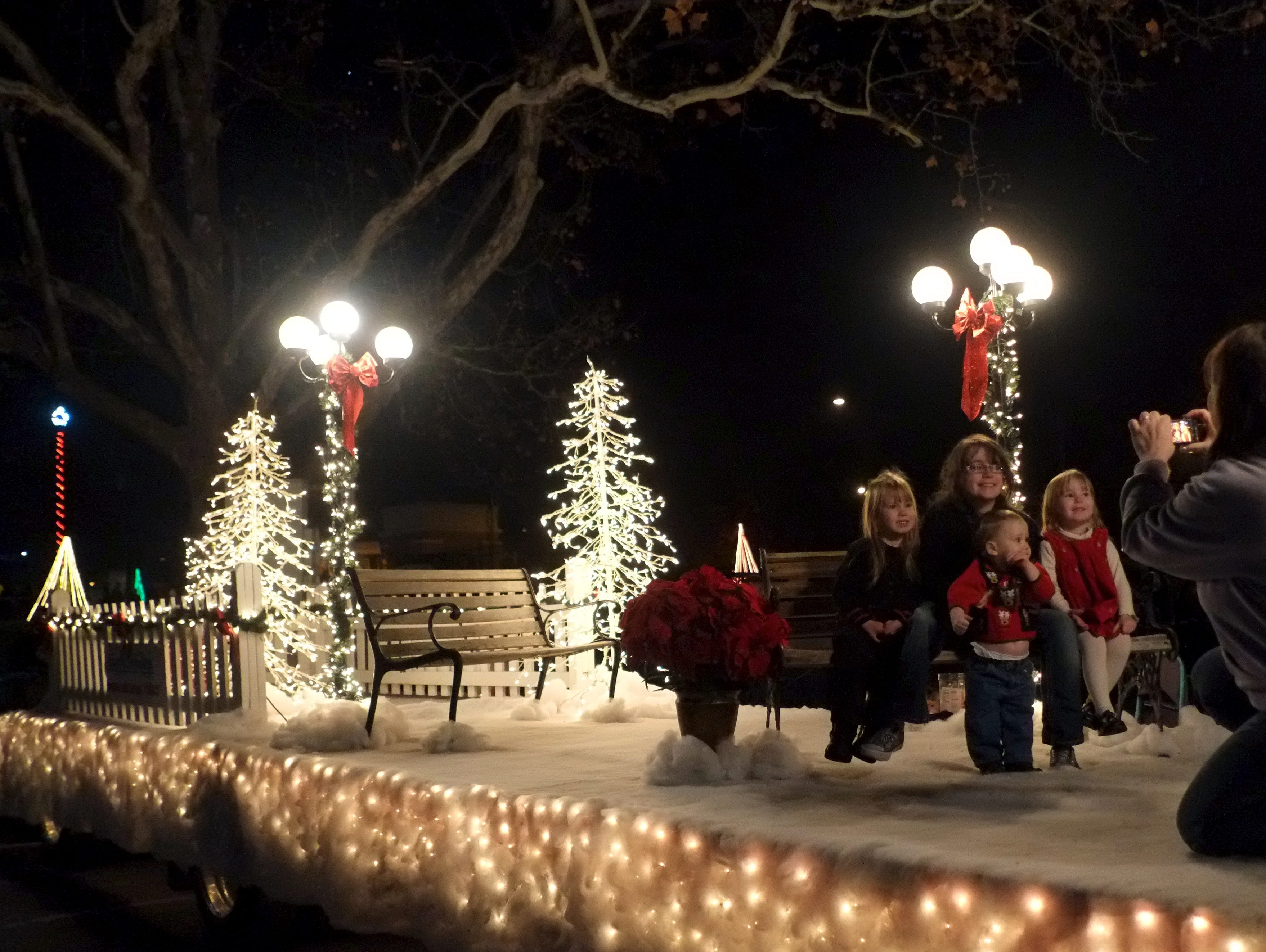 LeAnn Korth, right, takes a photo of, from left, Raleigh Korth, 5, Hannah Skeens, 14, Clay Korth, 1, and Sydney Korth, 4, on the Tennessee Valley Fair float on Friday, November 30, 2012 during Comcast Christmas at Chilhowee Park.
