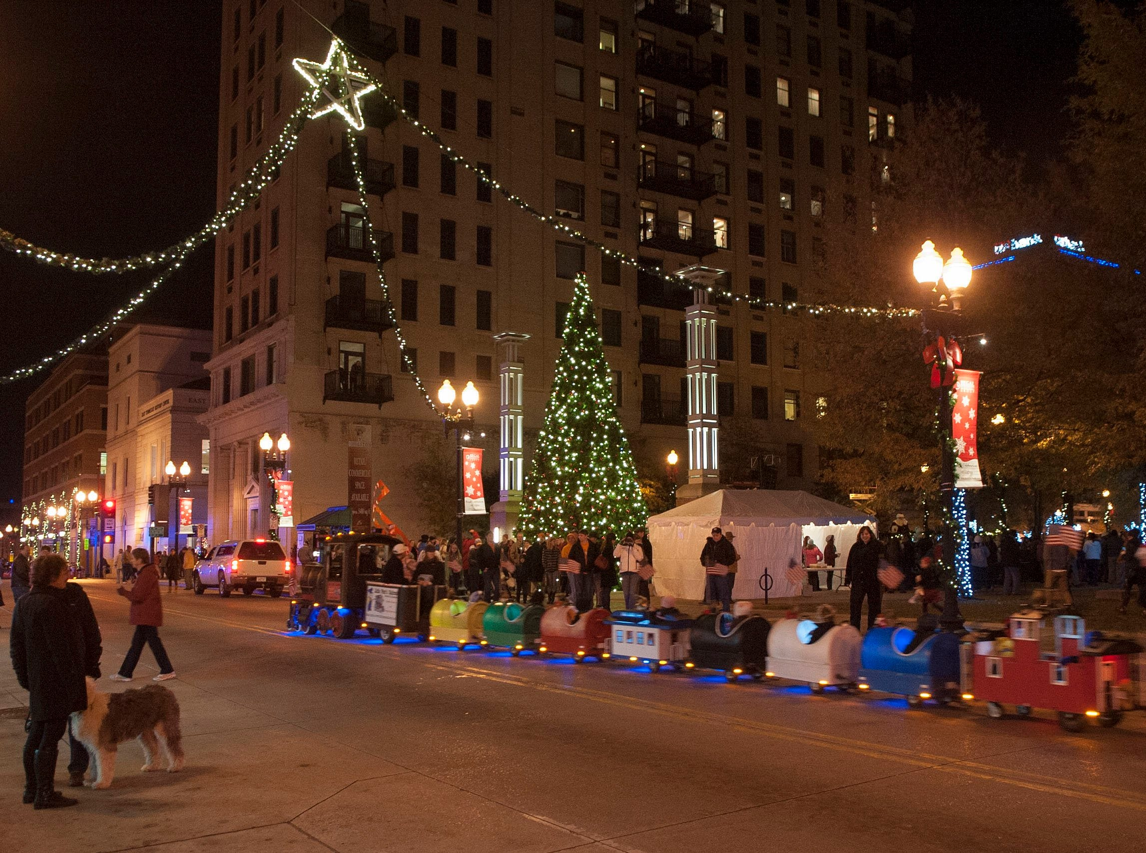 The Polar Express was offering rides to children on Gay Street at the Regal Celebration of Lights Friday night, kicking off Christmas in the city. Mayor Madeline Rogero was joined by David Ownby, Regal Entertainment CFO and Santa Claus the City of Knoxville turned on Christmas tree.