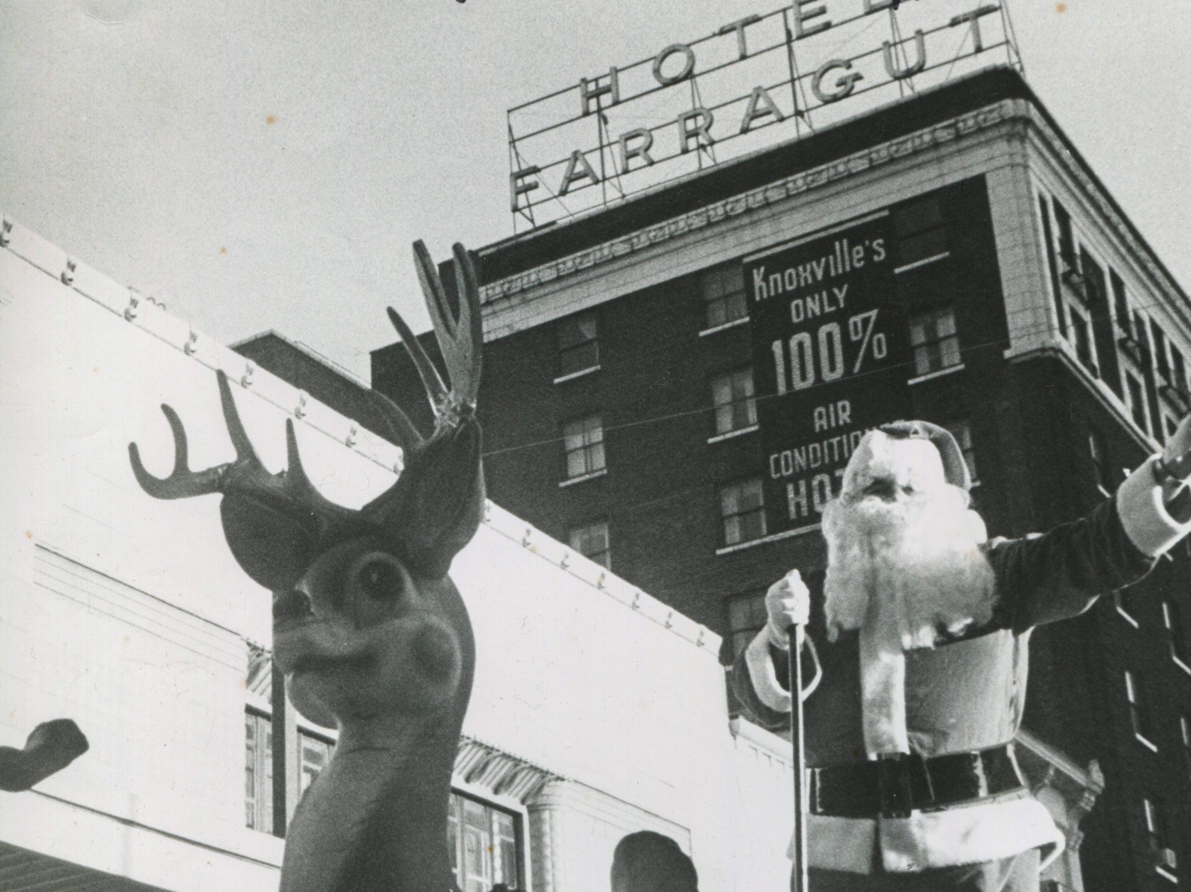 Santa waves during the Christmas parade on Saturday, Dec. 18, 1976, on Gay Street.