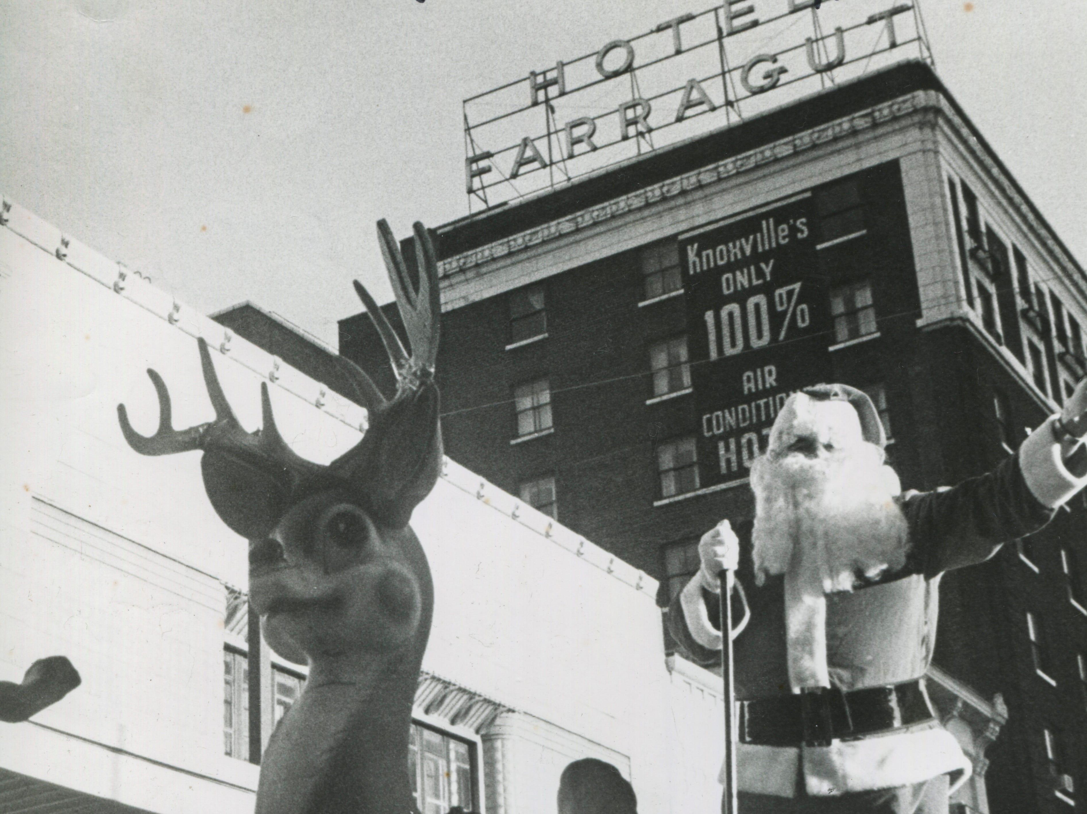 Santa waves during the Christmas parade on Saturday, Dec. 18, 1976, on Gay Street.