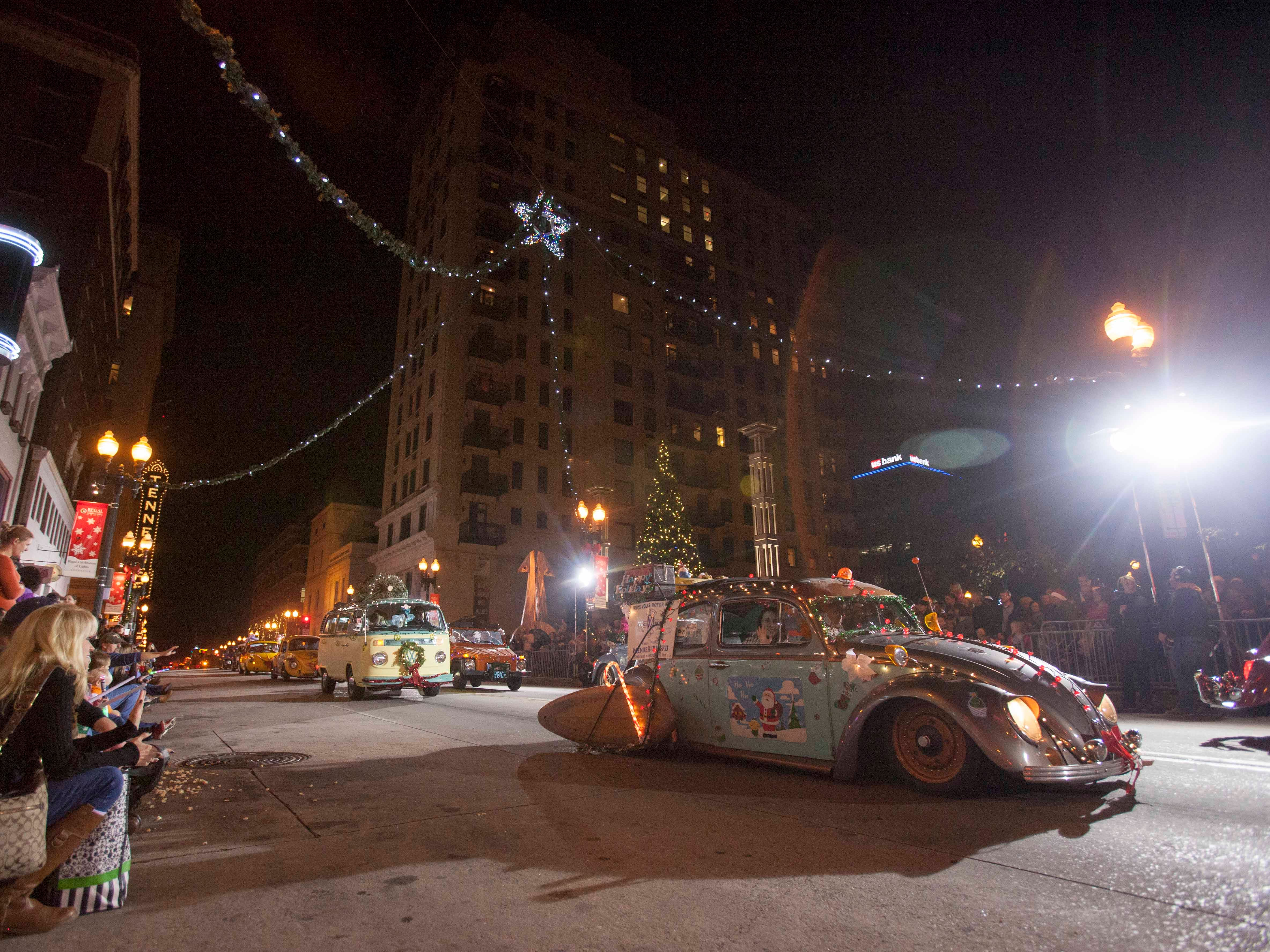 Members of the Knox Volks Motor Club drive their Volkswagens down Gay Street during the Christmas parade downtown Friday, Dec. 7, 2012.