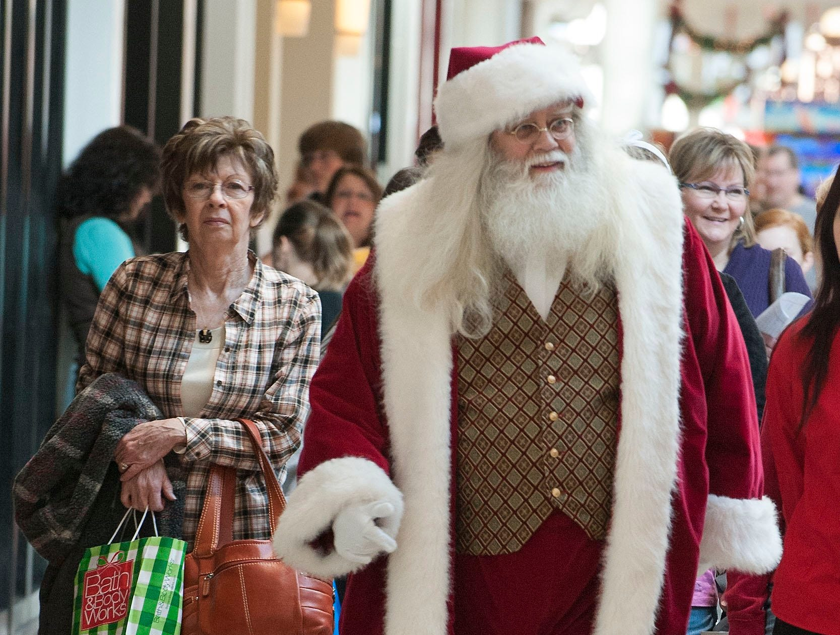 Santa Claus walks though West Town Mall  with Black Friday shoppers.  Black Friday is now in full swing with holiday shoppers filling the stores and malls in Knoxville.