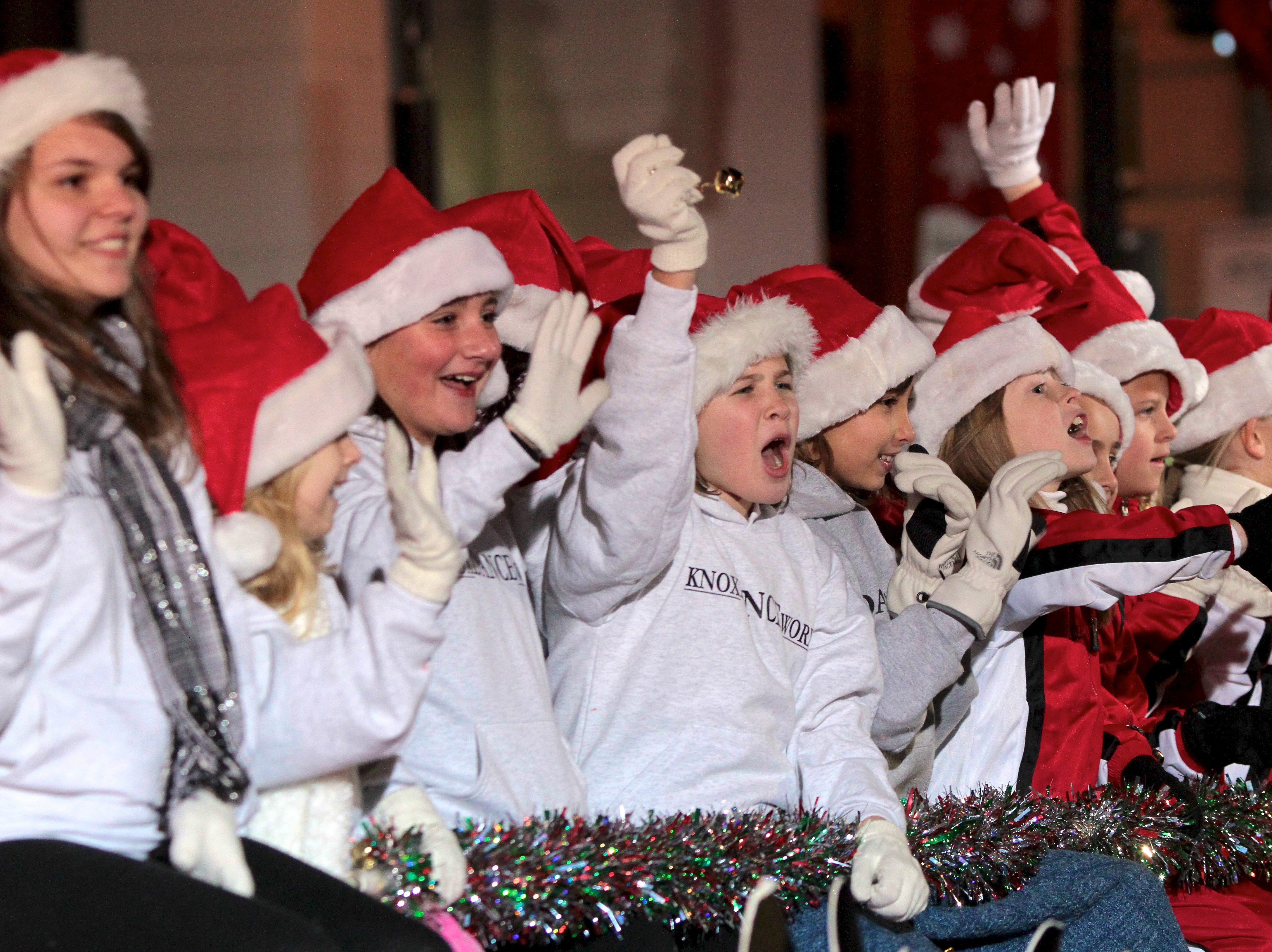 Kids on the Knox Dance Worx float wave during the annual Knoxville Christmas Parade on Friday, December 3, 2010.