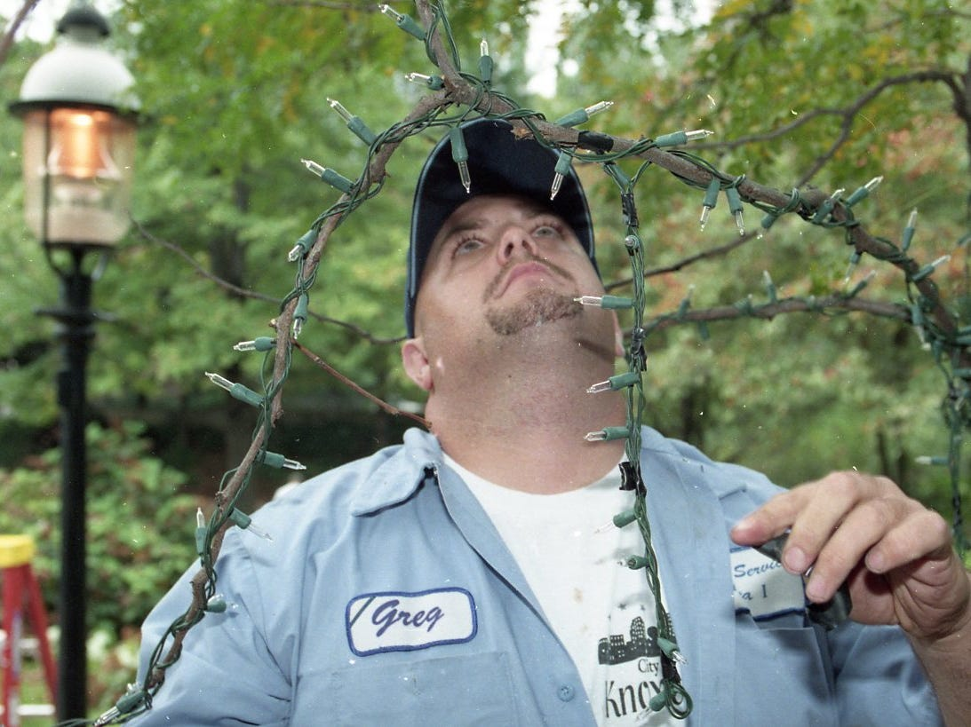 Greg Long of the City of Knoxville Public Service Department examines the Christmas lights he has put up along the trees at Krutch Park in October 1999 in downtown Knoxville in preparation for the oncoming holiday. The lighting ceremony is planned for the first weeks of December.