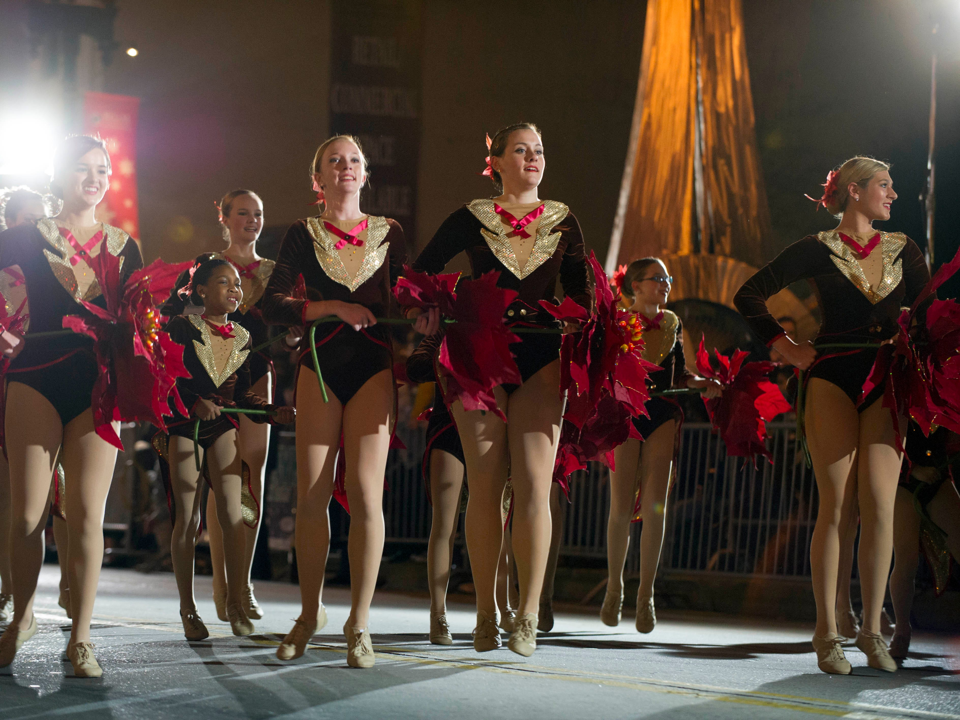 Members of the Angela Floyd School for Dance perform during the Christmas parade on Gay Street downtown Friday, Dec. 7, 2012.