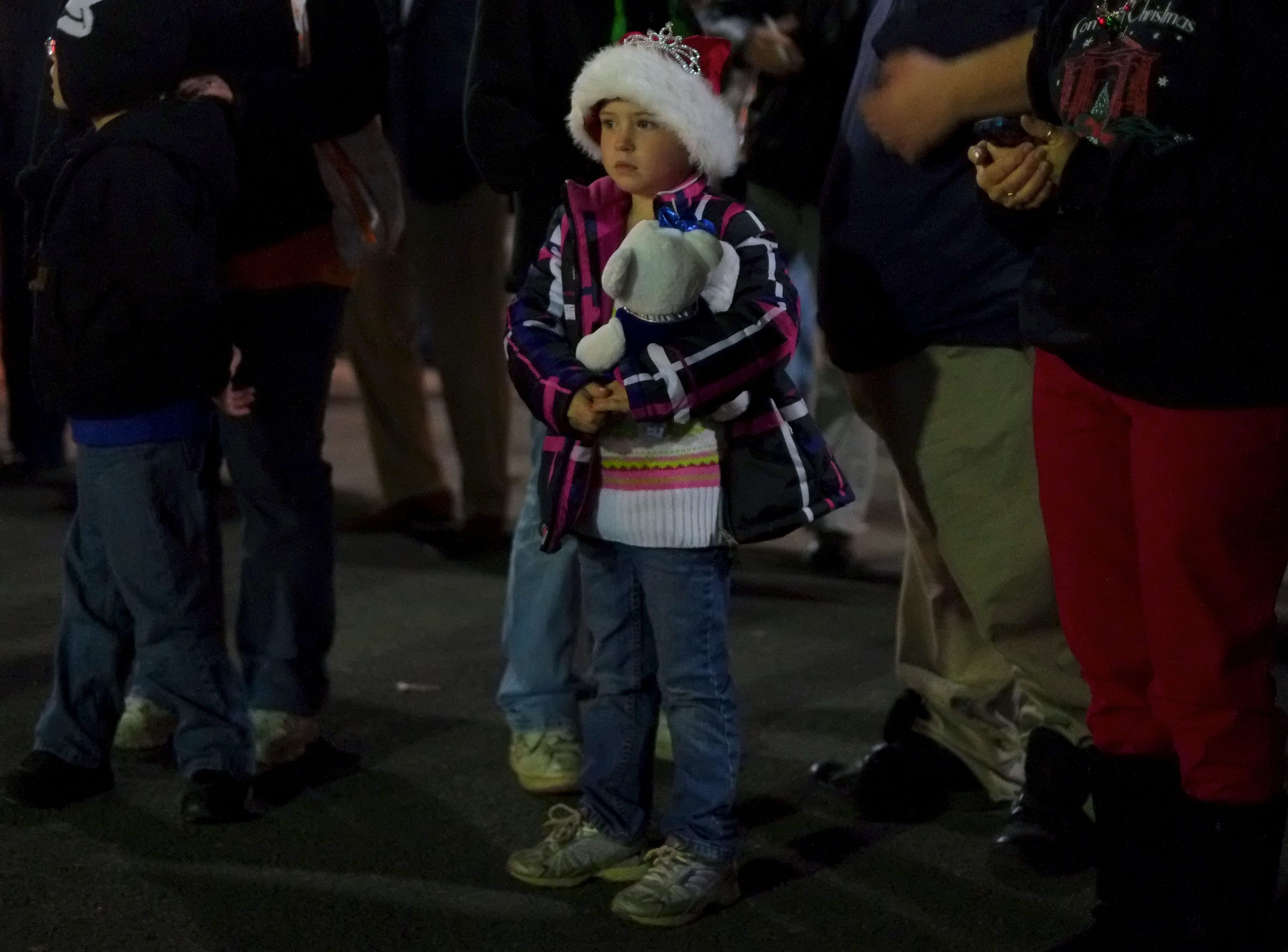 Jade Messamore, 5, center, waits for Santa to arrive on Friday, November 30, 2012 during Comcast Christmas at Chilhowee Park.