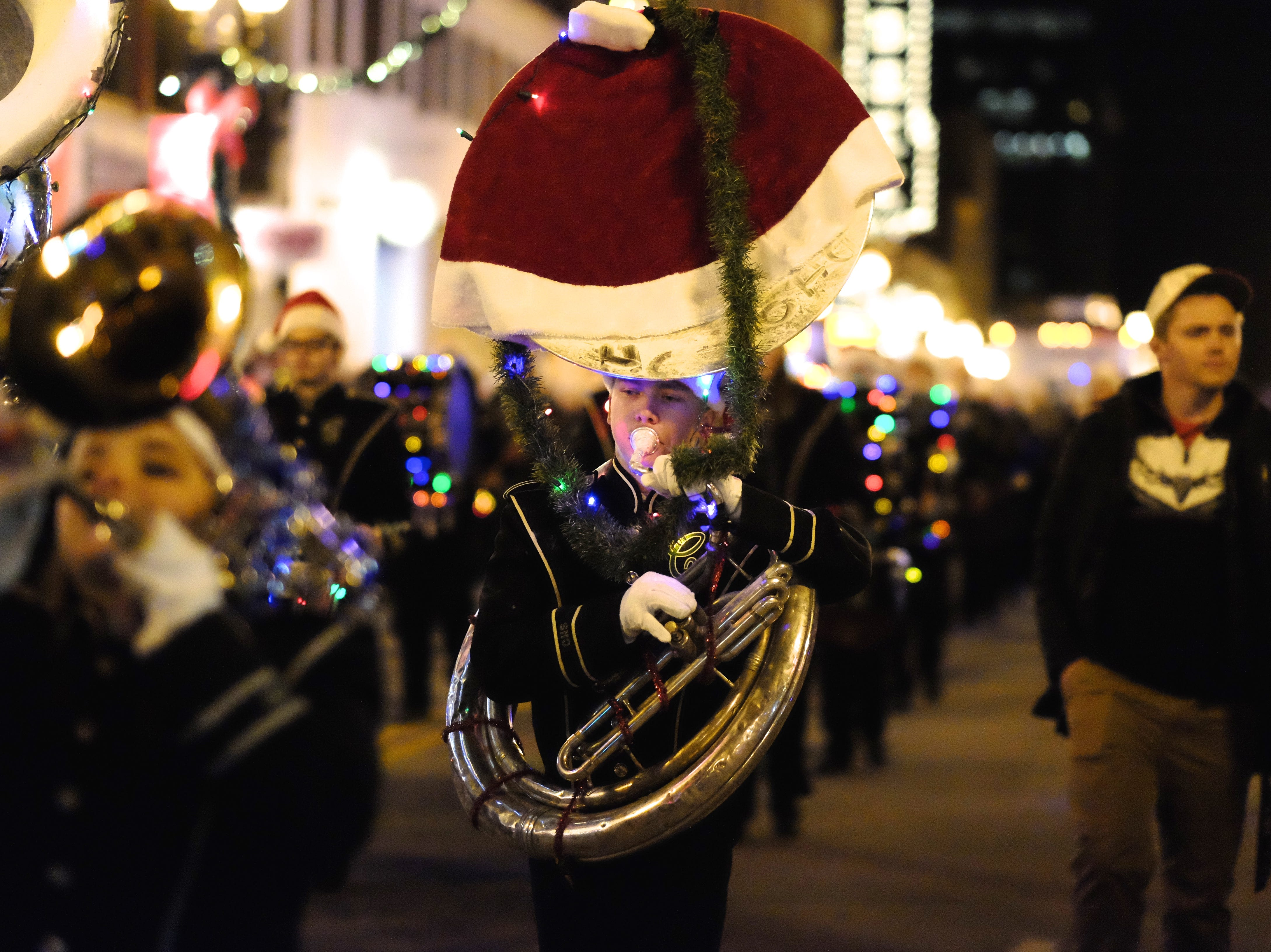 The Carter High School Marching Band makes their way down Gay Street during the 43rd annual WIVK Christmas Parade on Friday, December 4, 2015, in Knoxville.