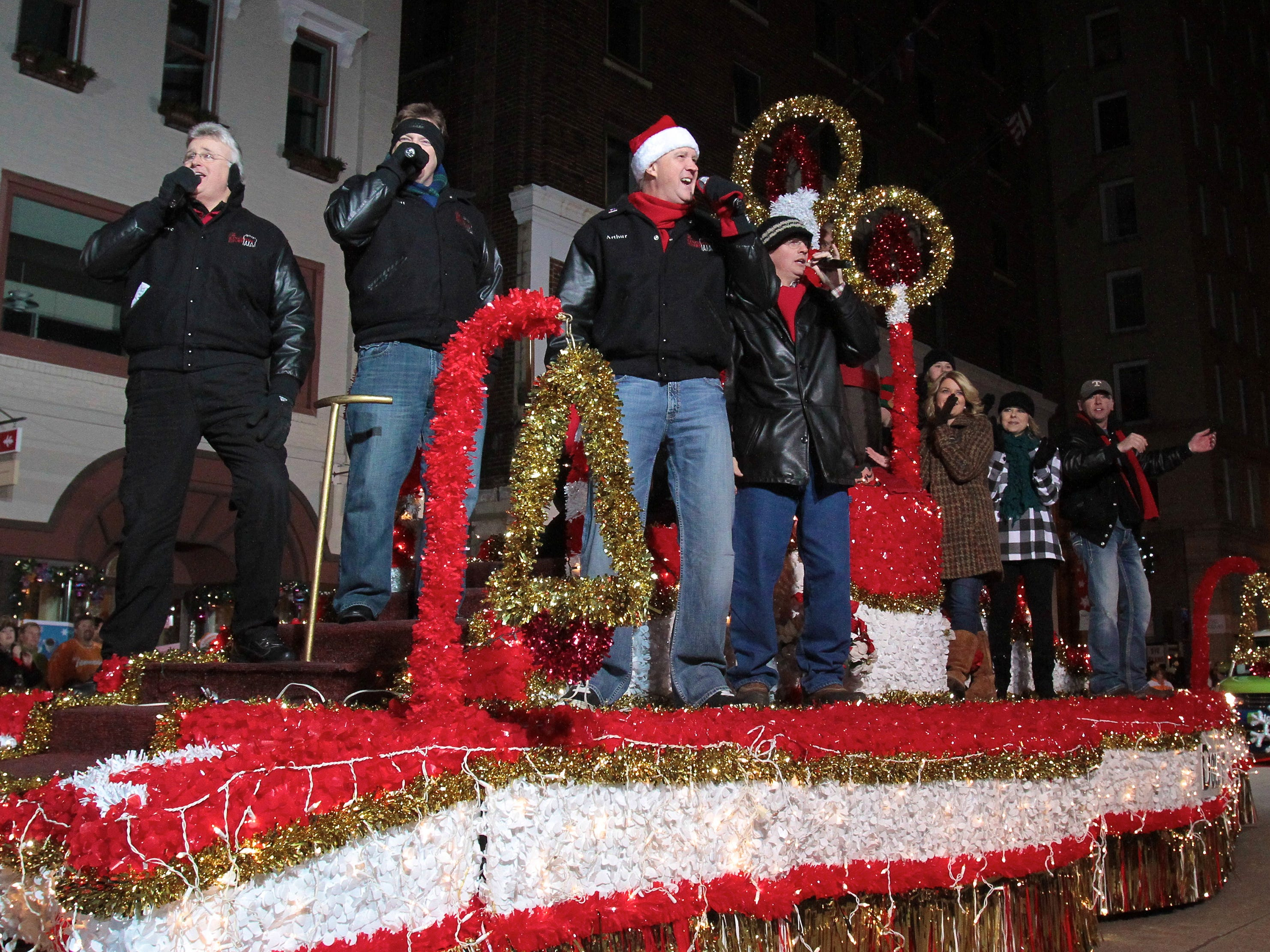 Members of the Kingdom Heirs from Dollywood perform on Gay Street during the annual Knoxville Christmas Parade on Friday, December 3, 2010.
