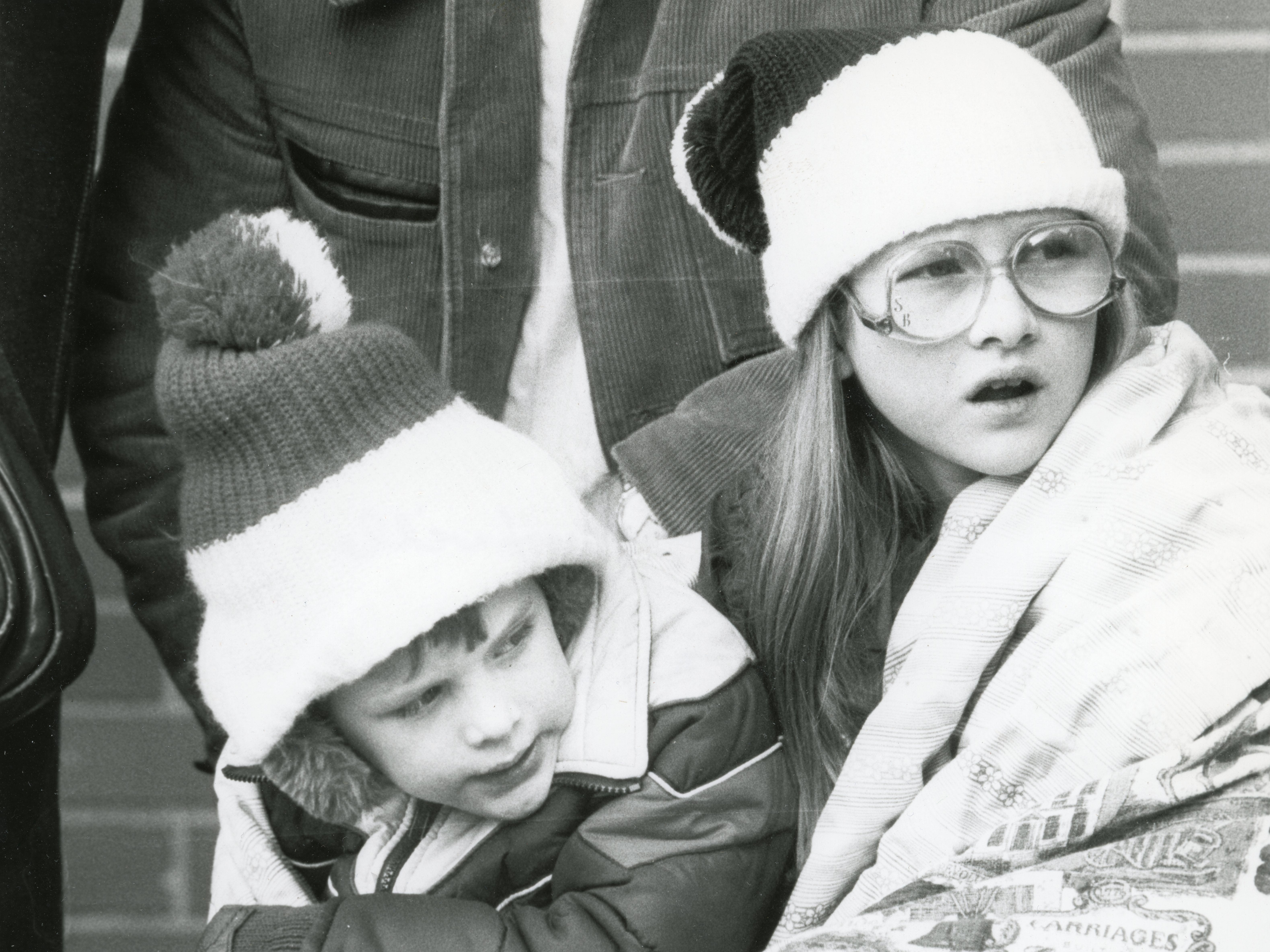Doug Brooks, 4, and Sheri Brooks, 11, watch the Knoxville Christmas Parade in December 1981.