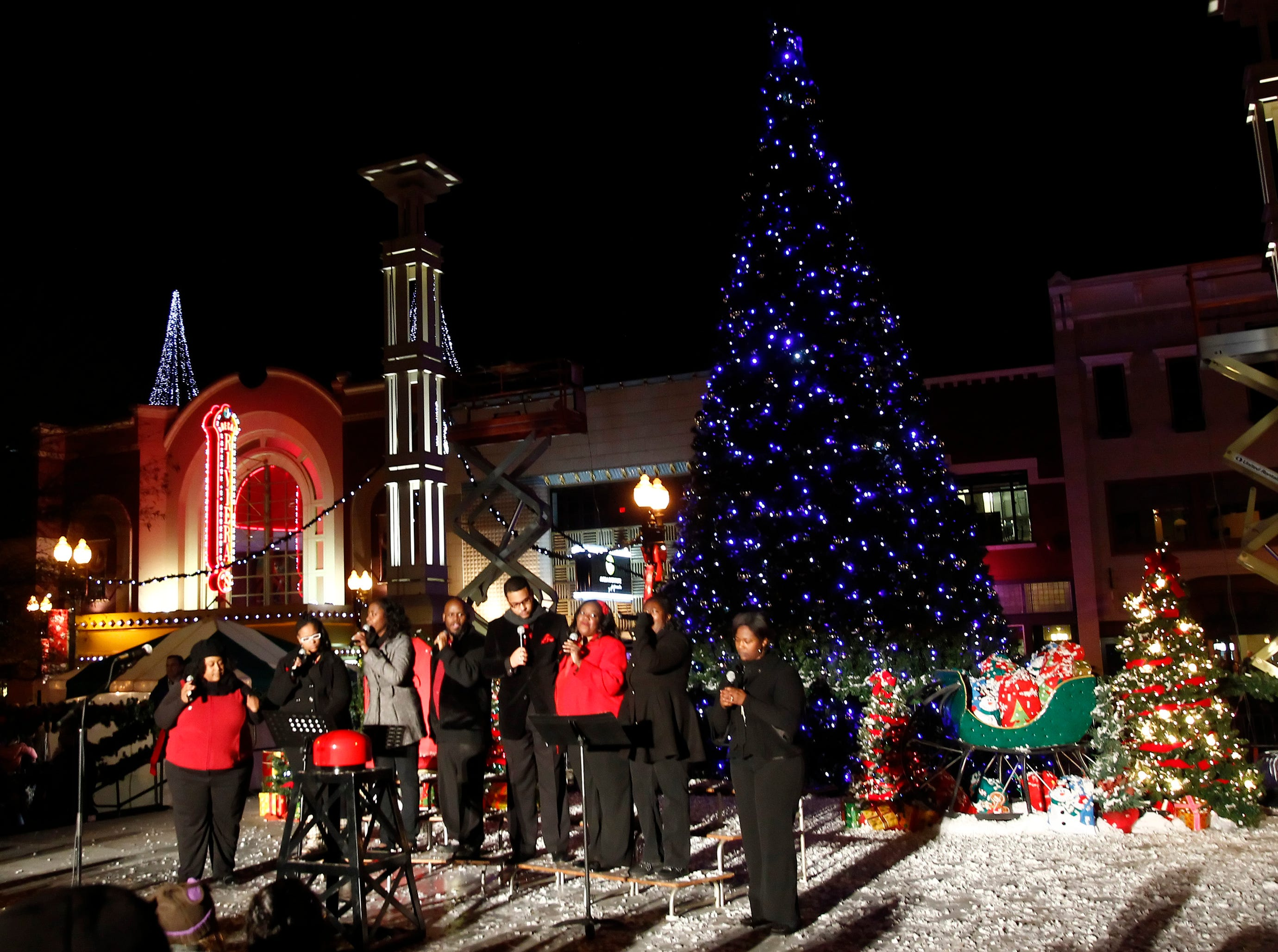 The Unity Choir performs during the lighting of the Christmas tree at Market Square Friday, Nov. 25, 2011.