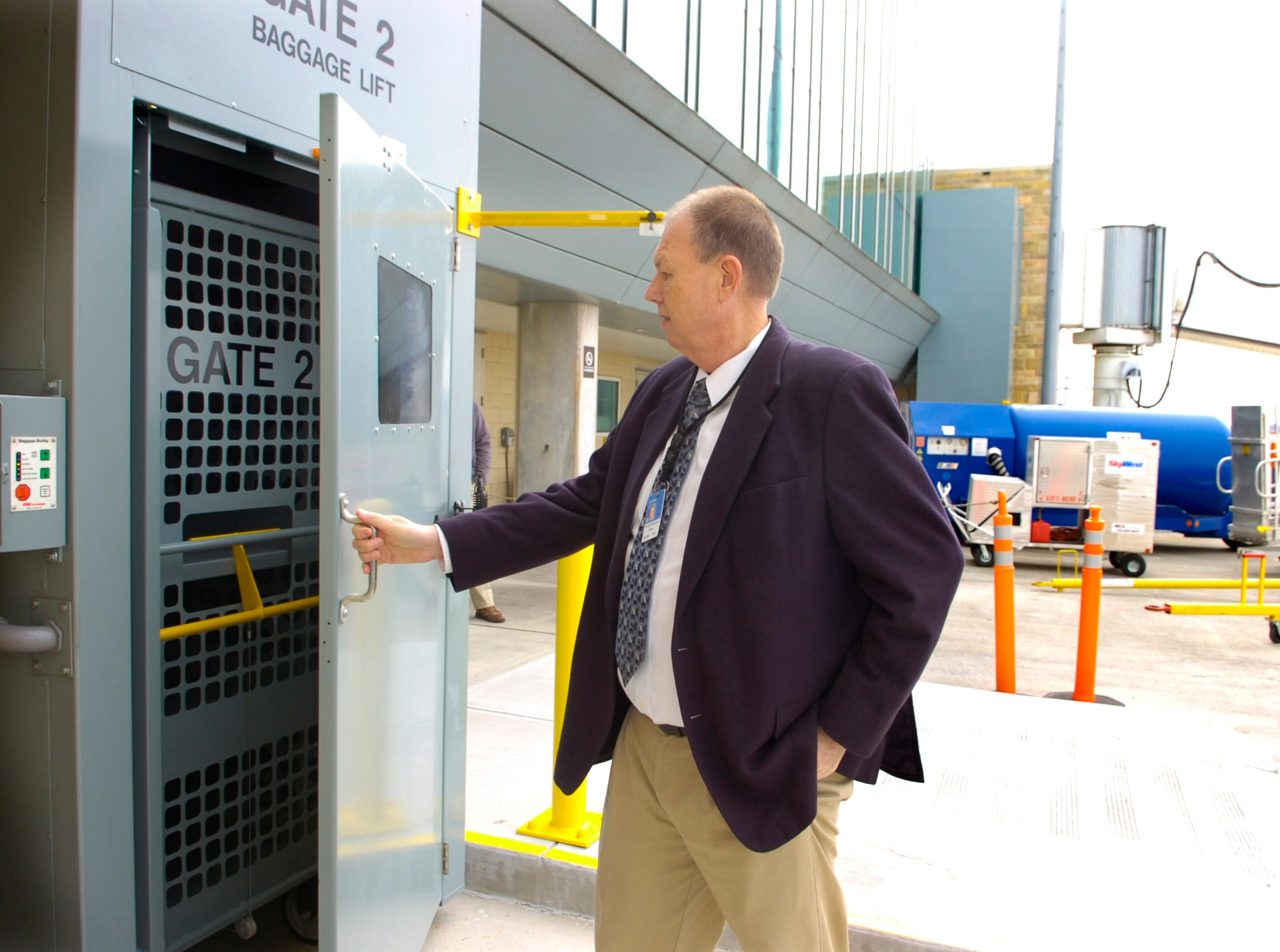 Bill Marrison, president of the Metropolitan Knoxville Airport Authority, demonstrates the Baggage Lift System that has been installed at all gates at McGhee Tyson Airport on Feb. 8, 2007. The new system reduces the need for passengers or airline personnel to transport baggage from the airport's second level to the ground level where it  is loaded on the aircraft.