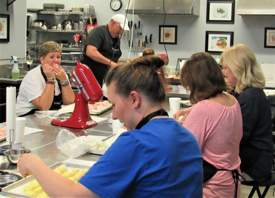 Krystyn Maxa samples macaroons during a baking class.