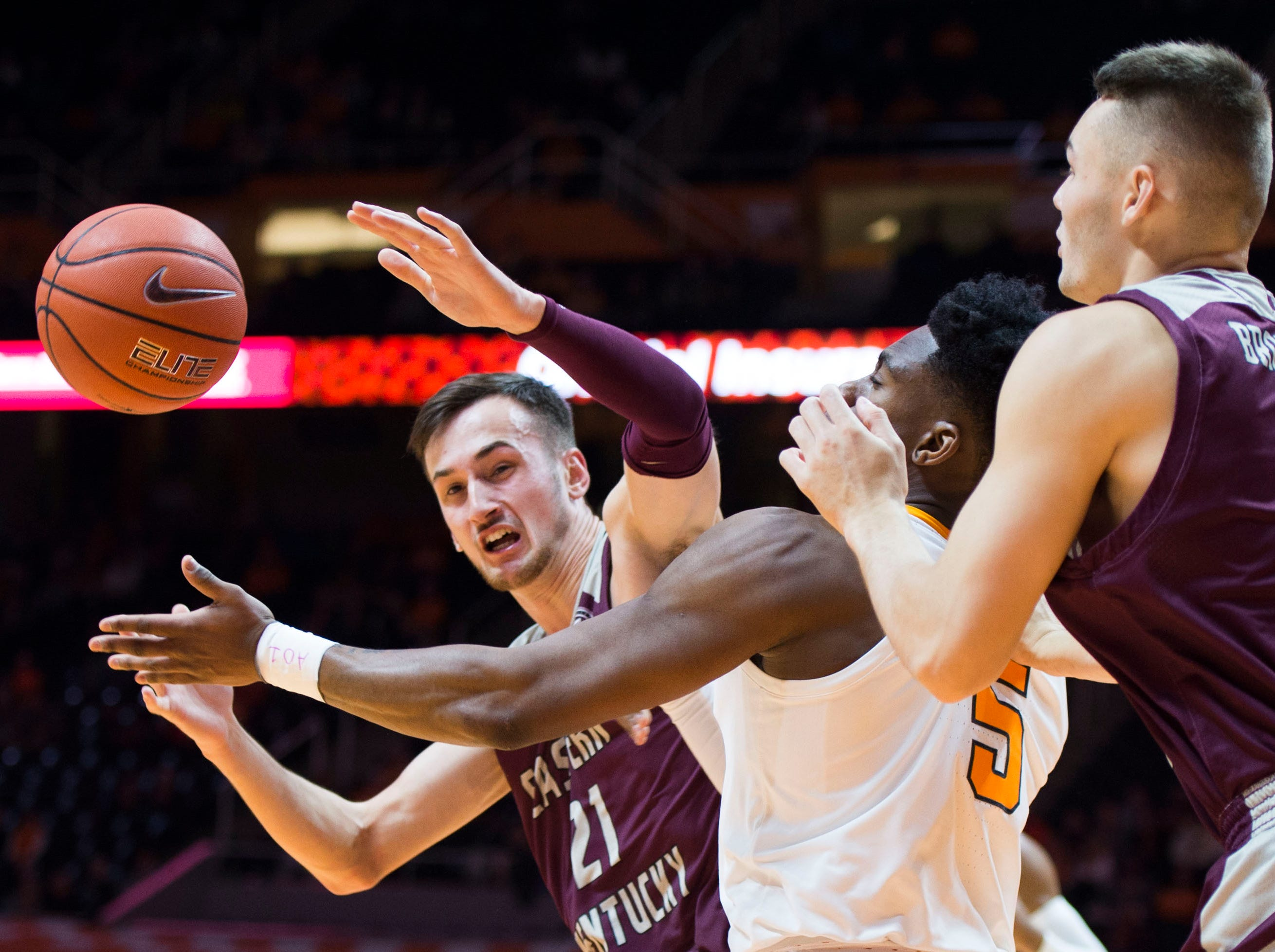 EKU's Lachlan Anderson (21) attempts to gain possession of the ball during the first half of a NCAA men's basketball game between Tennessee and Eastern Kentucky University at Thompson-Boling Arena Wednesday, Nov. 28, 2018.