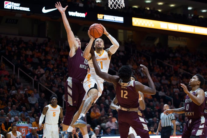 Tennessee's Lamonte Turner (1) takes a shot while defended by EKU's Nick Mayo (10) and EKU's Tre Kind (12) during the second half of a NCAA men's basketball game between Tennessee and Eastern Kentucky University at Thompson-Boling Arena Wednesday, Nov. 28, 2018. Tennessee defeated EKU 95-67.