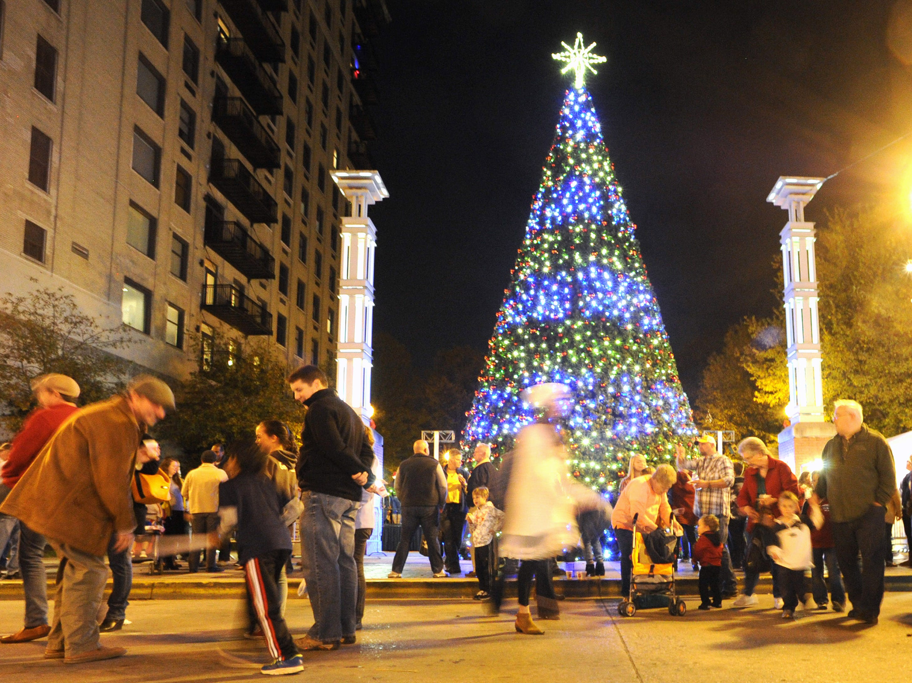Pedestrians spill onto Gay St. following the lighting of the city's new 42-foot-tall LED Christmas tree in Krutch Park on Friday, Nov. 27, 2015.