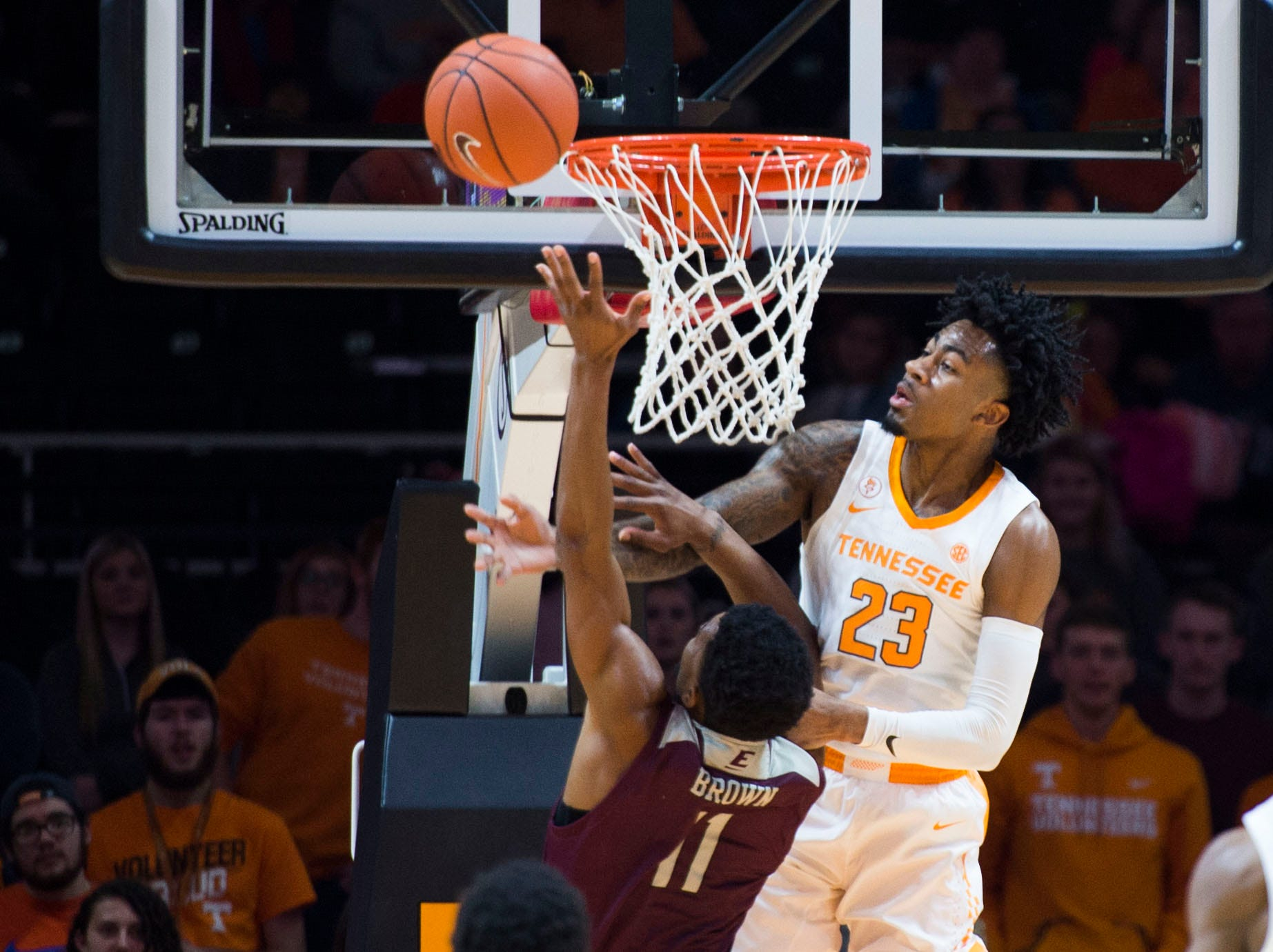 Tennessee's Jordan Bowden (23) defends a shot by EKU's Jomaru Brown (11) during the first half of a NCAA men's basketball game between Tennessee and Eastern Kentucky University at Thompson-Boling Arena Wednesday, Nov. 28, 2018.