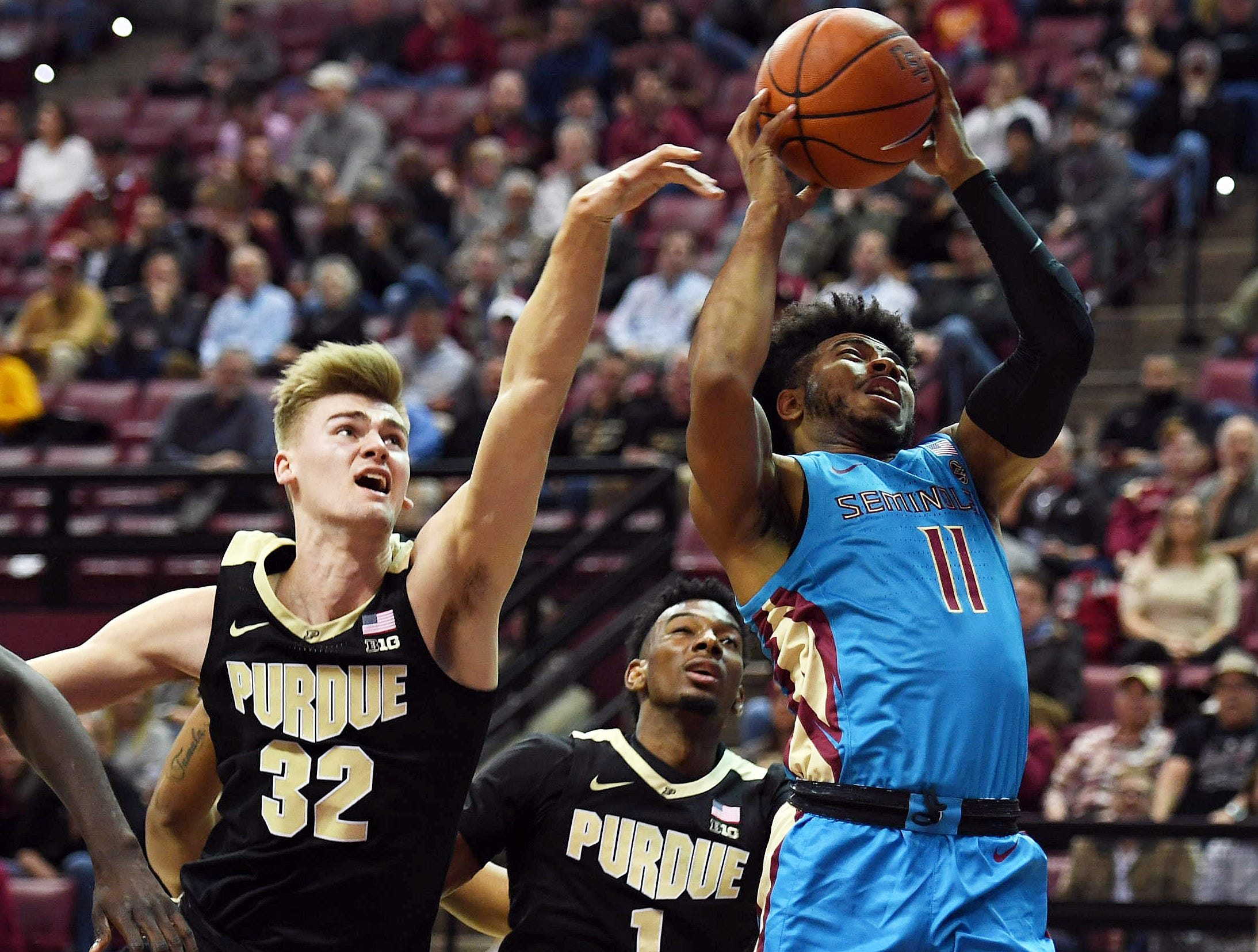 Nov 28, 2018; Tallahassee, FL, USA; Florida State Seminoles guard David Nichols (11) shoots against Purdue Boilermakers center Matt Haarms (32) during the first half at Donald L. Tucker Center. Mandatory Credit: Melina Myers-USA TODAY Sports