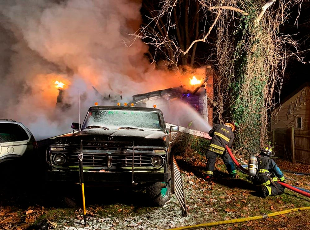 Firefighters battle an early morning house fire on Wednesday, Nov. 28, 2018 in Logansport, Ind.  Authorities say four children and two adults are unaccounted for following the house fire.  Cass County Sheriff Randy Pryor told reporters at the scene in Logansport that the six are still believed to be inside the home that burned early Wednesday.  (Mitchell Kirk/The Kokomo Tribune via AP)