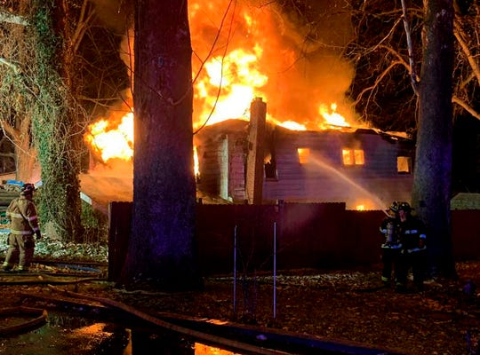 Firefighters battle an early morning house fire that killed six people on Wednesday, Nov. 28, 2018 in Logansport, Ind.
