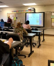 Brandon Rousseau teaches an adult education math course at South Louisiana Community College in Lafayette.