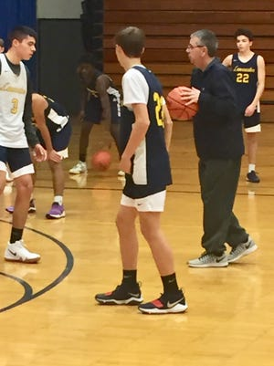 Lancaster boys basketball coach Kent Riggs gives instructions to his team during practice. The Gales will open the season Friday at Teays Valley.