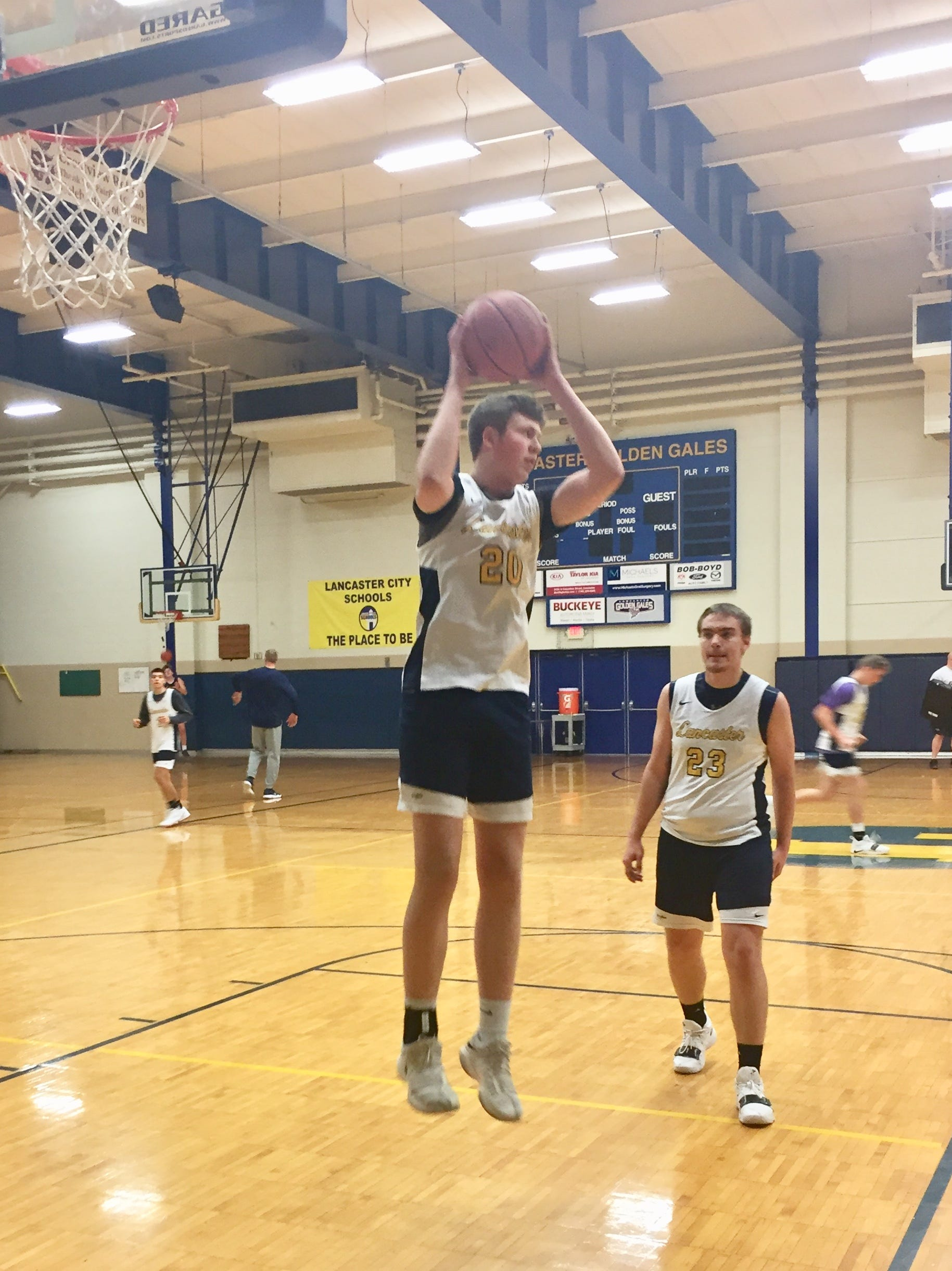 Lancaster senior Carson Thomas grabs a rebound in a drill during practice. The Gales will open the season Friday at Teays Valley.
