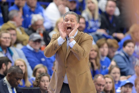 John Calipari yells for his team during the Monmouth game.