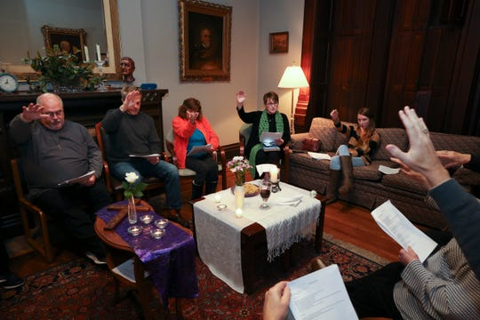 Mary Sue Barnett, center, leads a service at the First Unitarian Church.  She is a woman priest who was ordained by the Association of Roman Catholic Women Priests.  Nov. 26, 2018