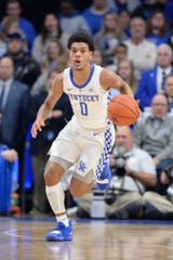 Quade Green dribbles in UK's game vs. Monmouth.