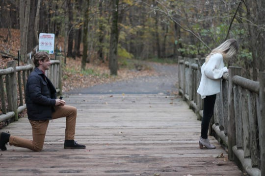 Shannon Keene poses for a photo at Cherokee Park.  She has no idea her boyfriend, Blake Martin is about to ask her to marry him.