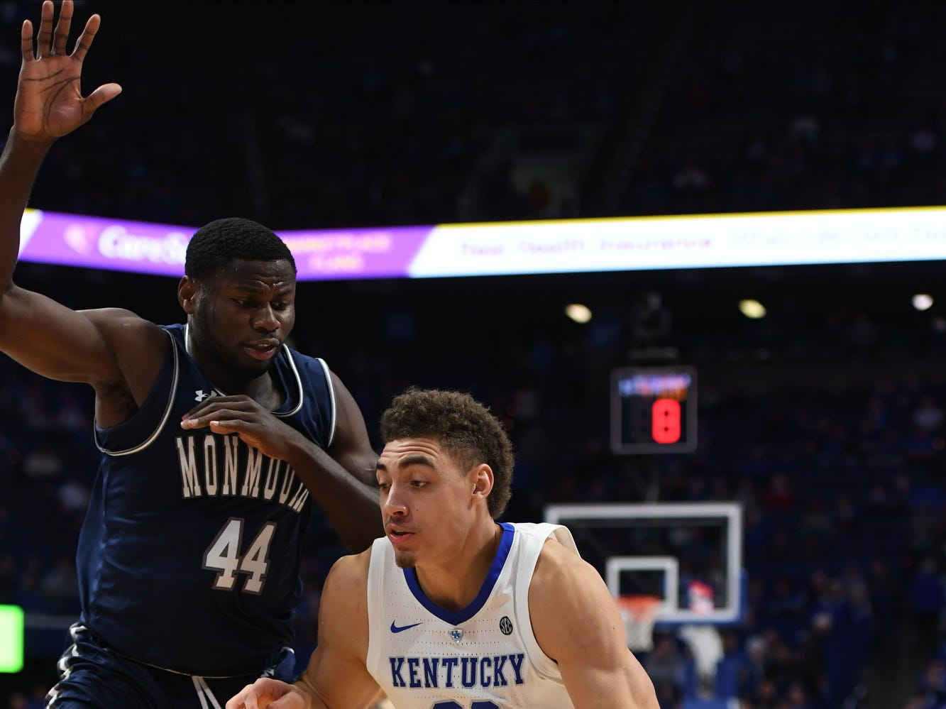 UK F Reid Travis drives with the ball during the University of Kentucky mens basketball game against Monmouth at Rupp Arena in Lexington, Kentucky on Wednesday, November 28, 2018.