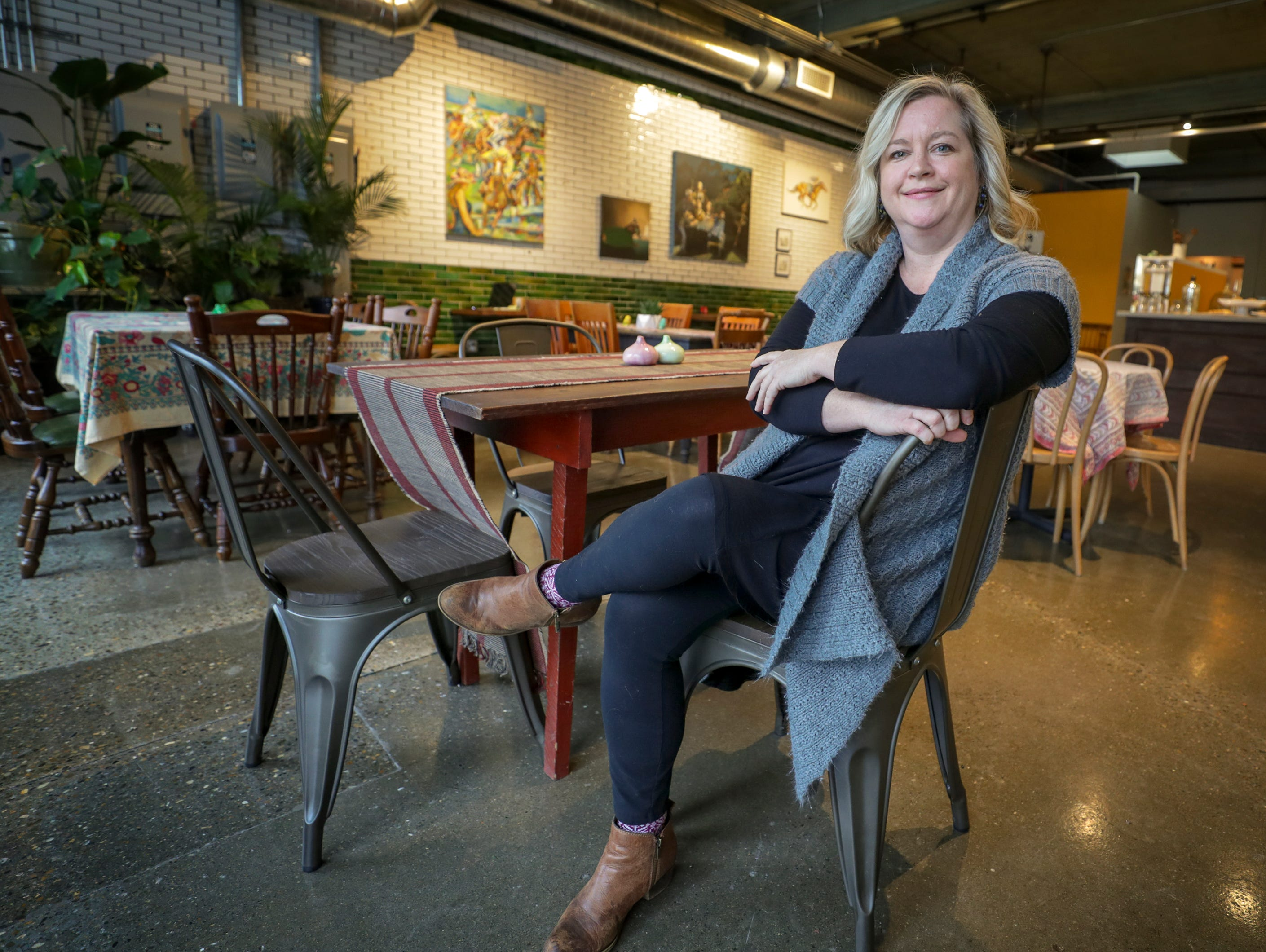 Sherry Hurley-Magnuson poses at her new cafe Farm To Fork in Portland.  
