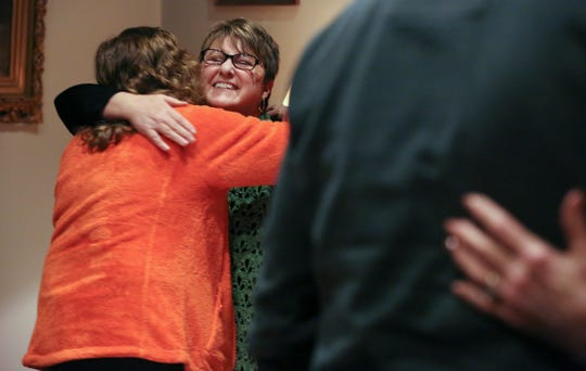 Mary Sue Barnett embraced Cindy Starr, left, during a service at the First Unitarian Church.  Barnett lead the service and is a woman priest who was ordained by the Association of Roman Catholic Women Priests.  