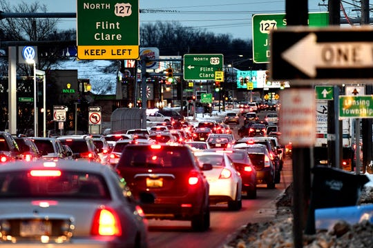 Traffic travels east on Saginaw Street near the U.S. 127 ramps during the evening rush hour on Wednesday, Nov. 28, 2018, in Lansing.