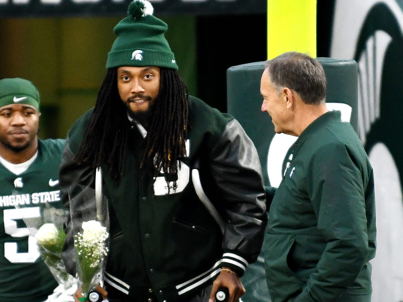 Michigan State senior Felton Davis III, left, stand with head coach Mark Dantonio as Felton is recognized during a ceremony before the game against Rutgers on Saturday, Nov. 24, 2018, at Spartan Stadium in East Lansing.