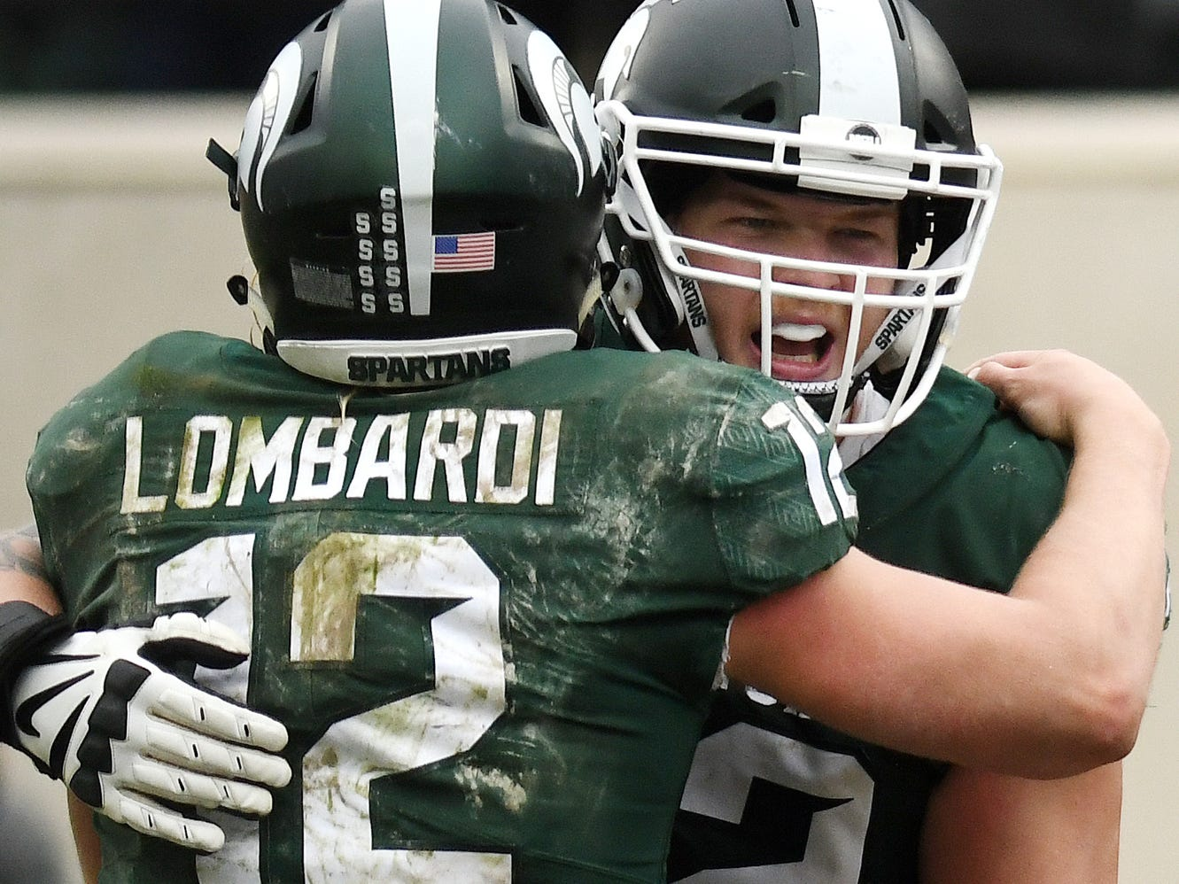 Michigan State's Rocky Lombardi, left, celebrates with teammate Luke Campbell after Jalen Nailor's touchdown during the fourth quarter on Saturday, Oct. 27, 2018, at Spartan Stadium in East Lansing.